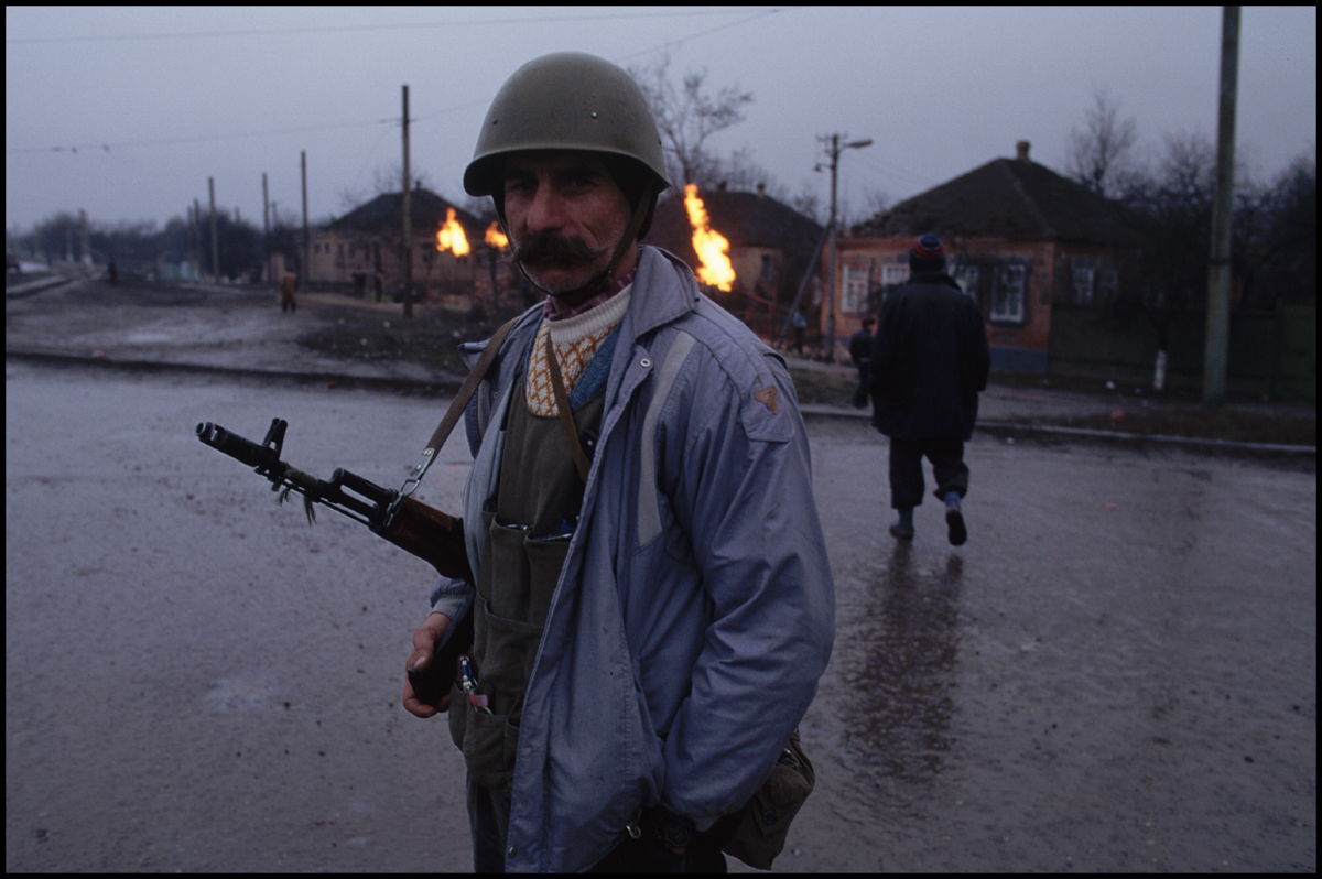 10 Jan 1995, Grozny, Russia --- A Chechen rebel patrols the streets of Grozny at dusk. The rebels are fighting Russian troops for the independence of Chechnya.