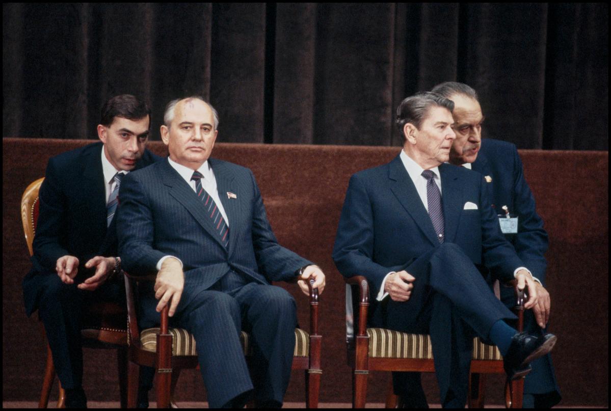 November 1985, Geneva, Switzerland --- Translators speak into the ears of Soviet leader Mikhail Gorbachev and United States President Ronald Reagan at the 1985 Geneva Summit.
