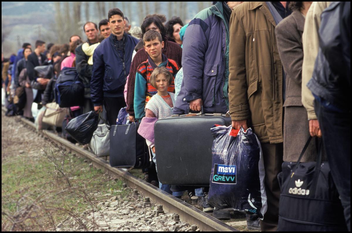 02 Apr 1999, Macedonia --- A long line of ethnic Albanians follow railroad tracks to the border between Kosovo and Macedonia.