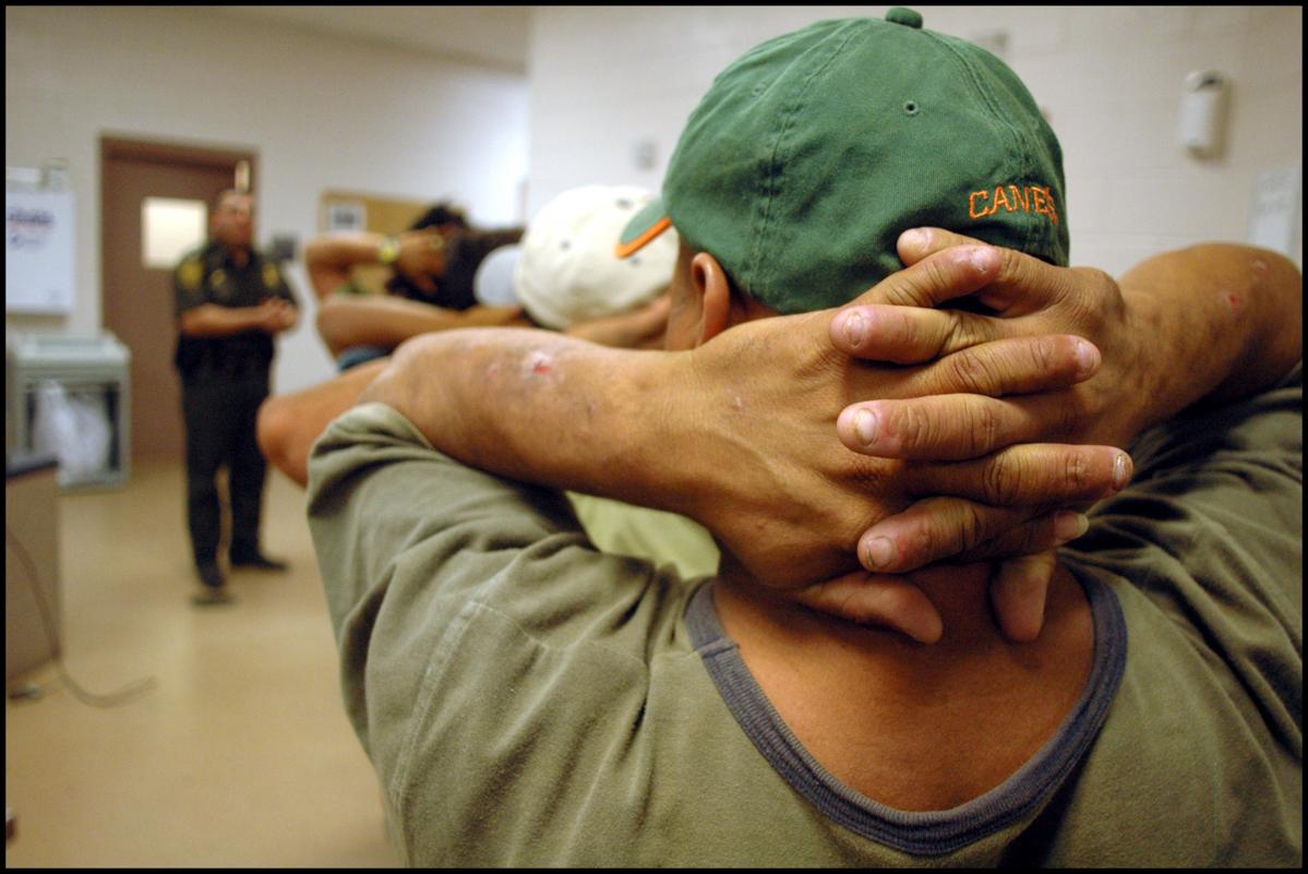 22 Jun 2006, Laredo, Texas, USA --- June_22_2006. A Border Portfolio. In Laredo, TX., US Border Patrol agents apprehend undocumented aliens that have tried to cross in to the US