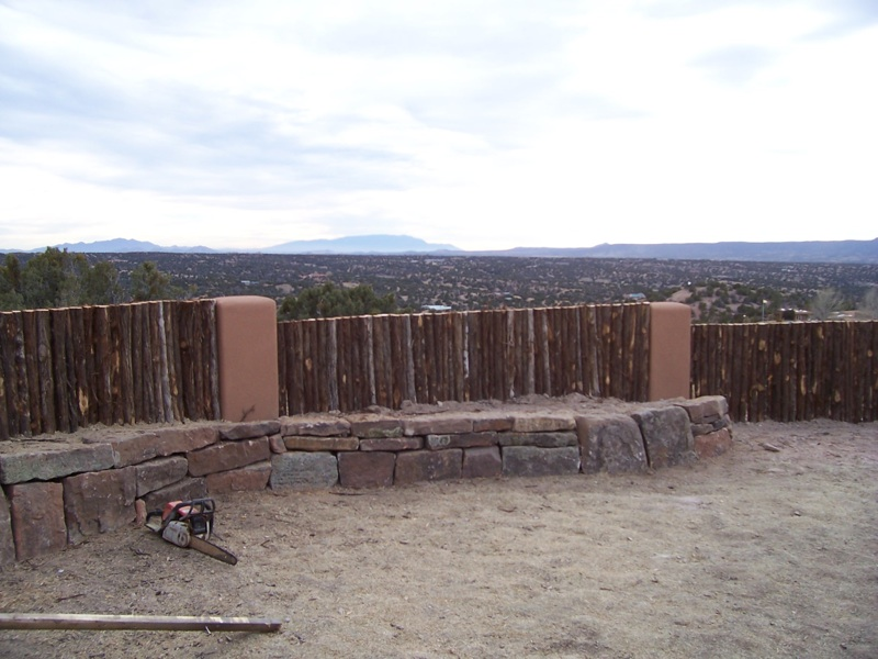 Contemporary coyote fence with stucco pillars
