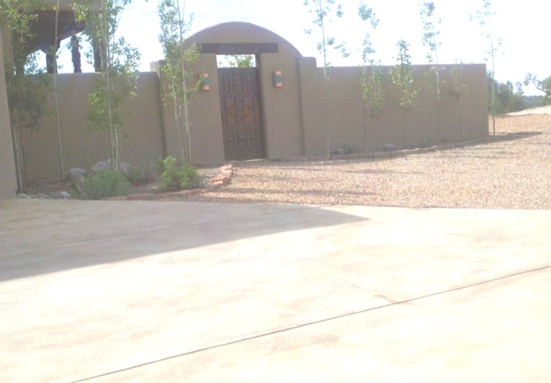 Garden wall with arched entry gate
