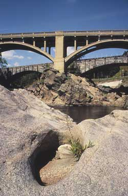 The historic Vilas and Boston and Maine bridges over The Great Falls of the Connecticut River in the dry season. The bridges connect Bellows Falls with Walpole, NH.