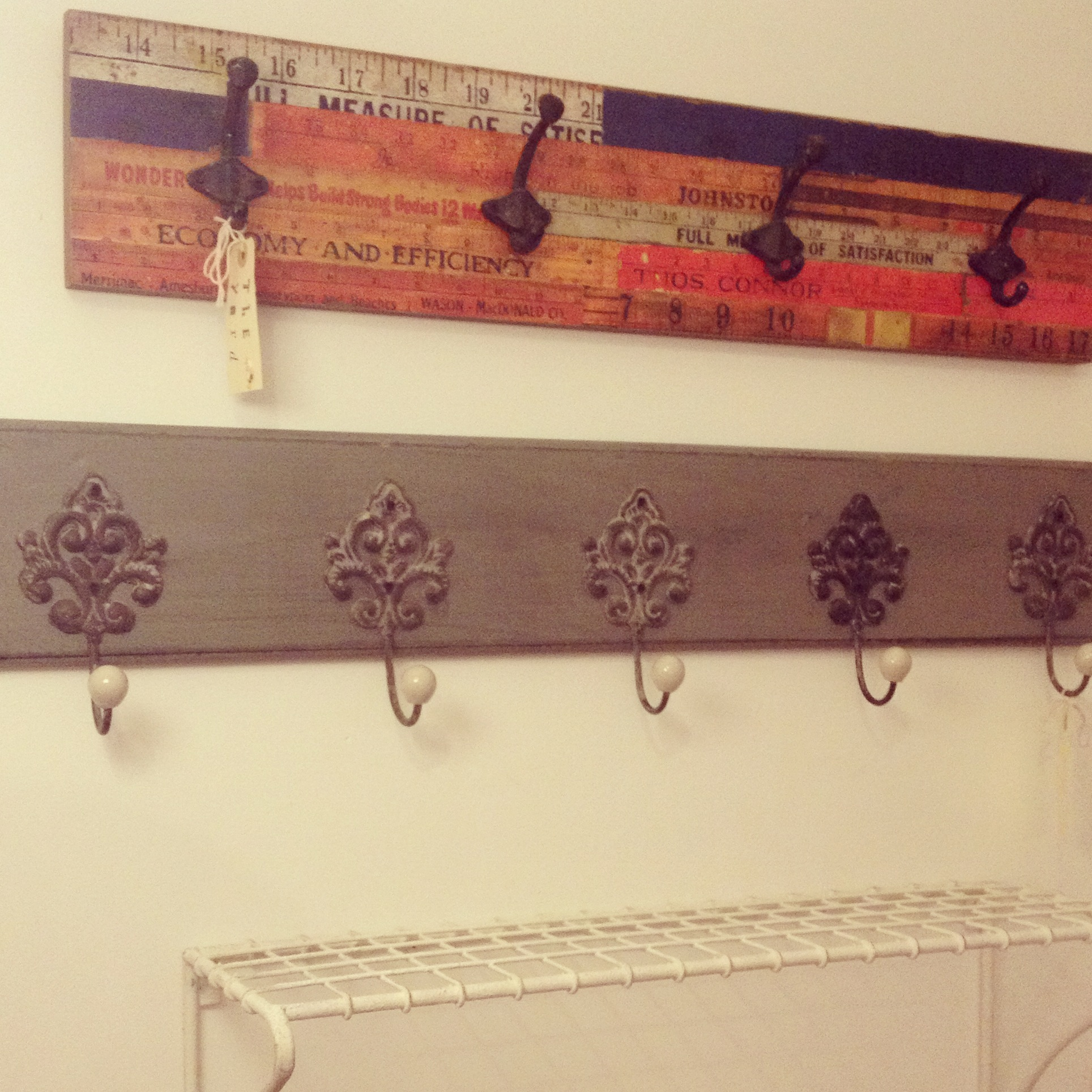 Grey rack with filigree hooks