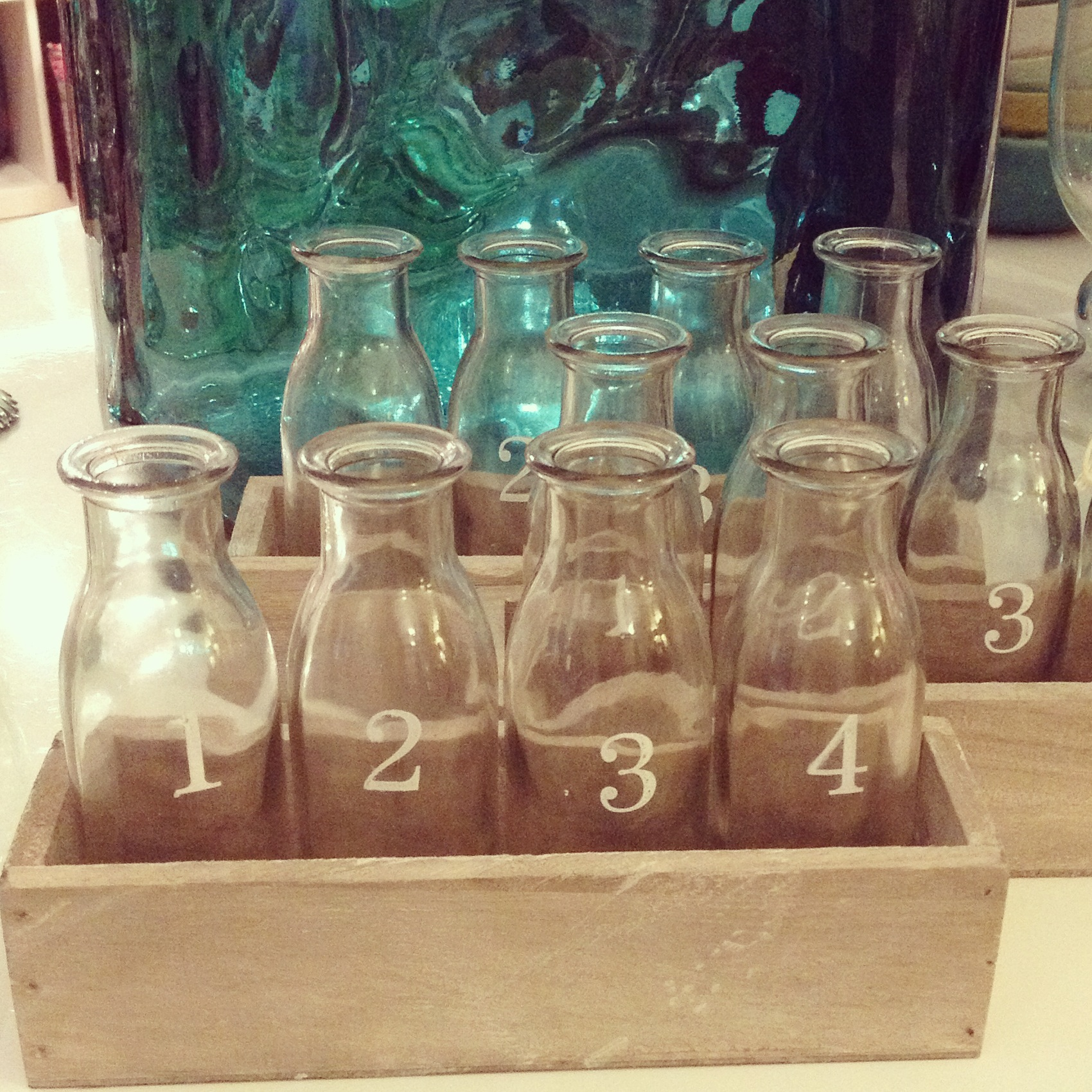 Tray with four numbered bottles