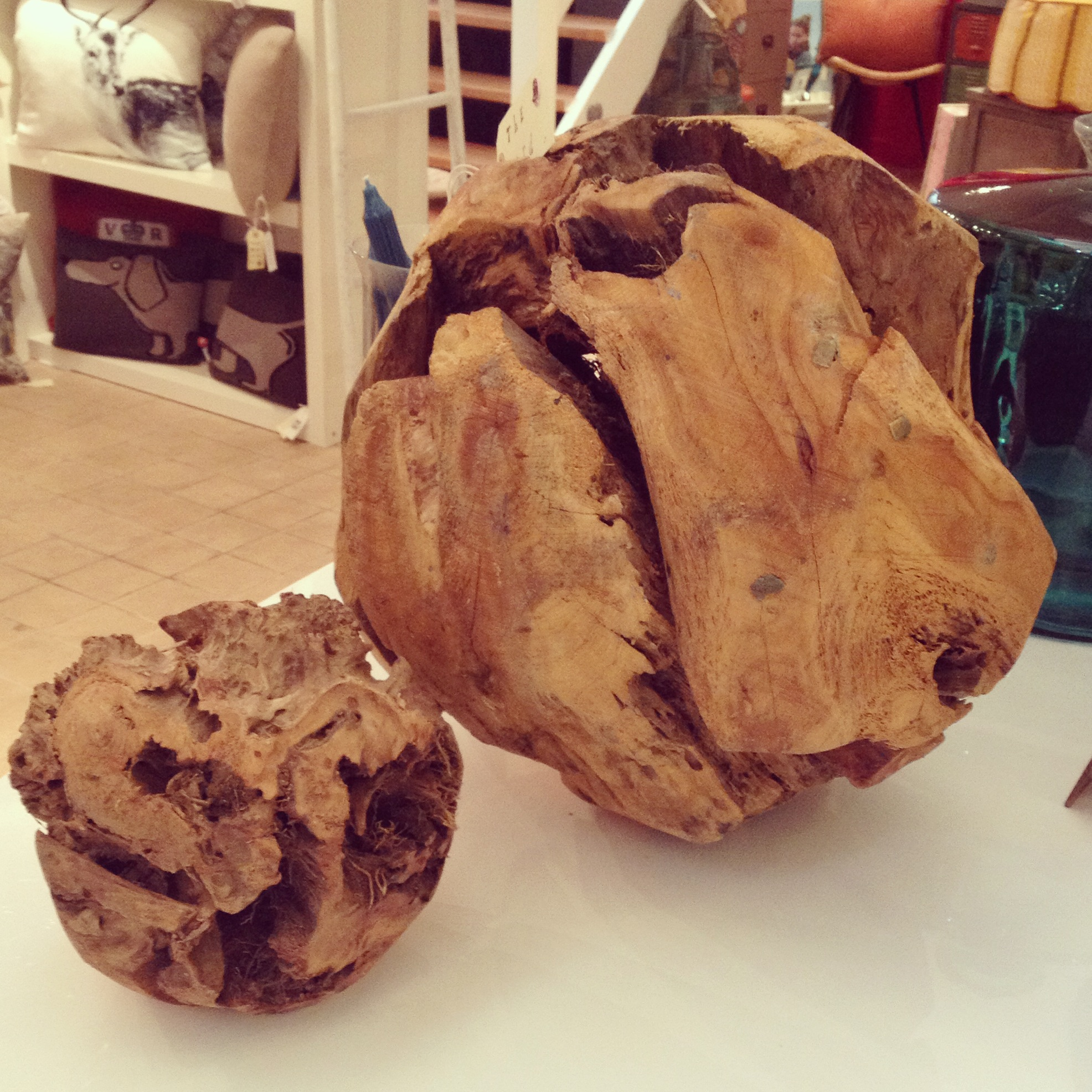 Large and small decorative balls made of tree roots