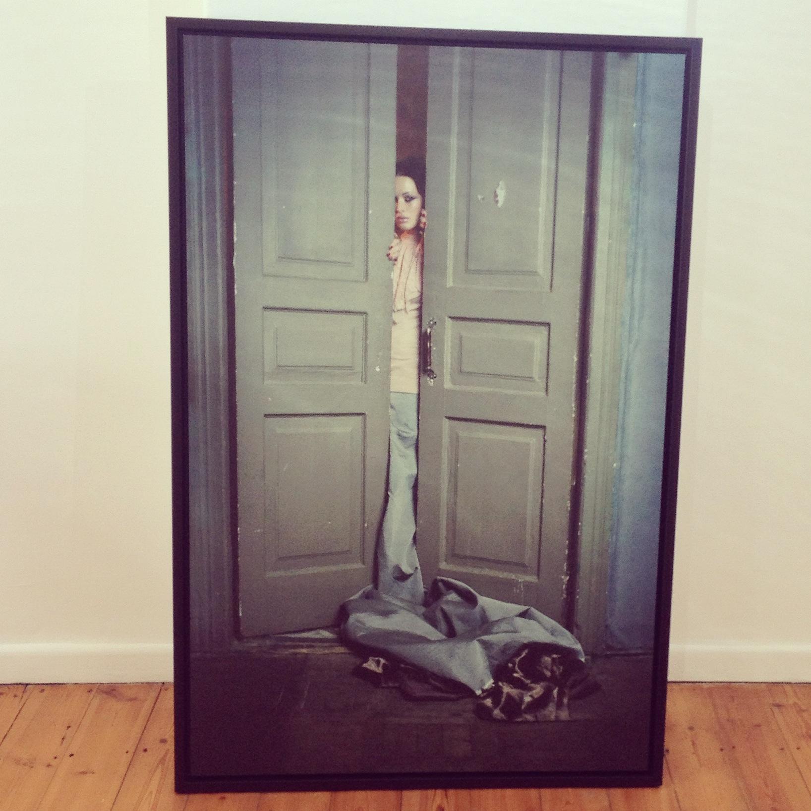 Women in doorway framed canvas