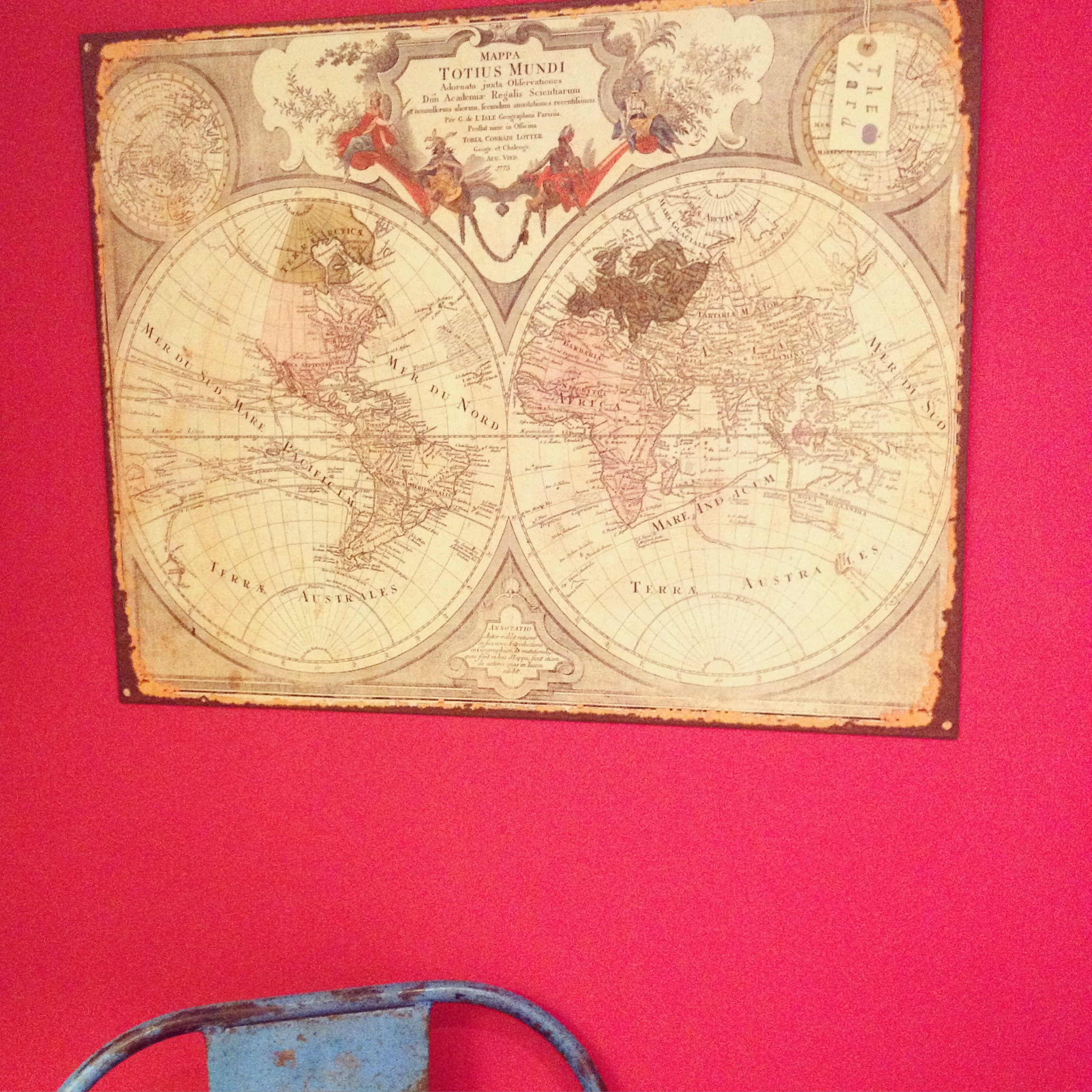 Metal world map wall plaque