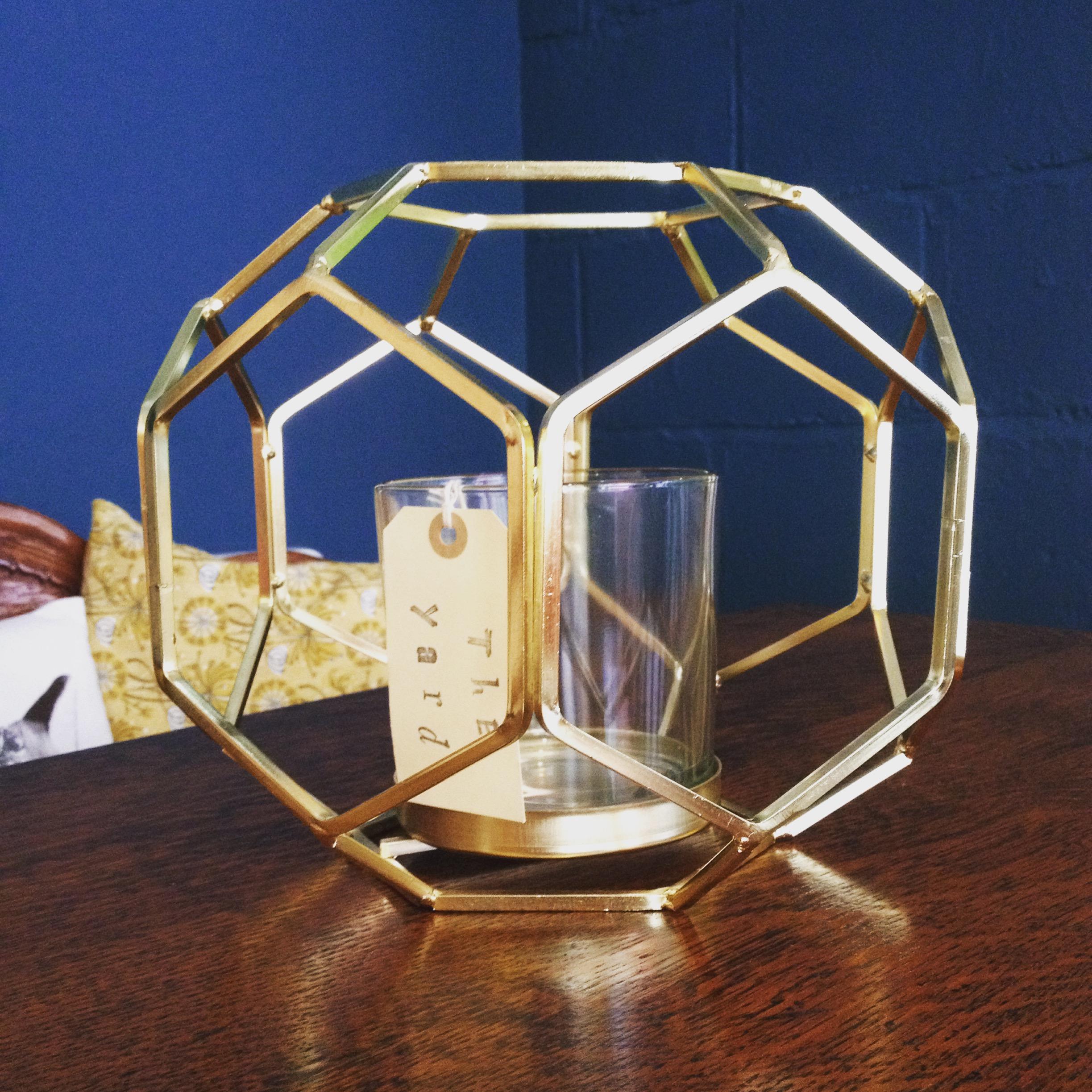 Hexagonal gold and glass lantern