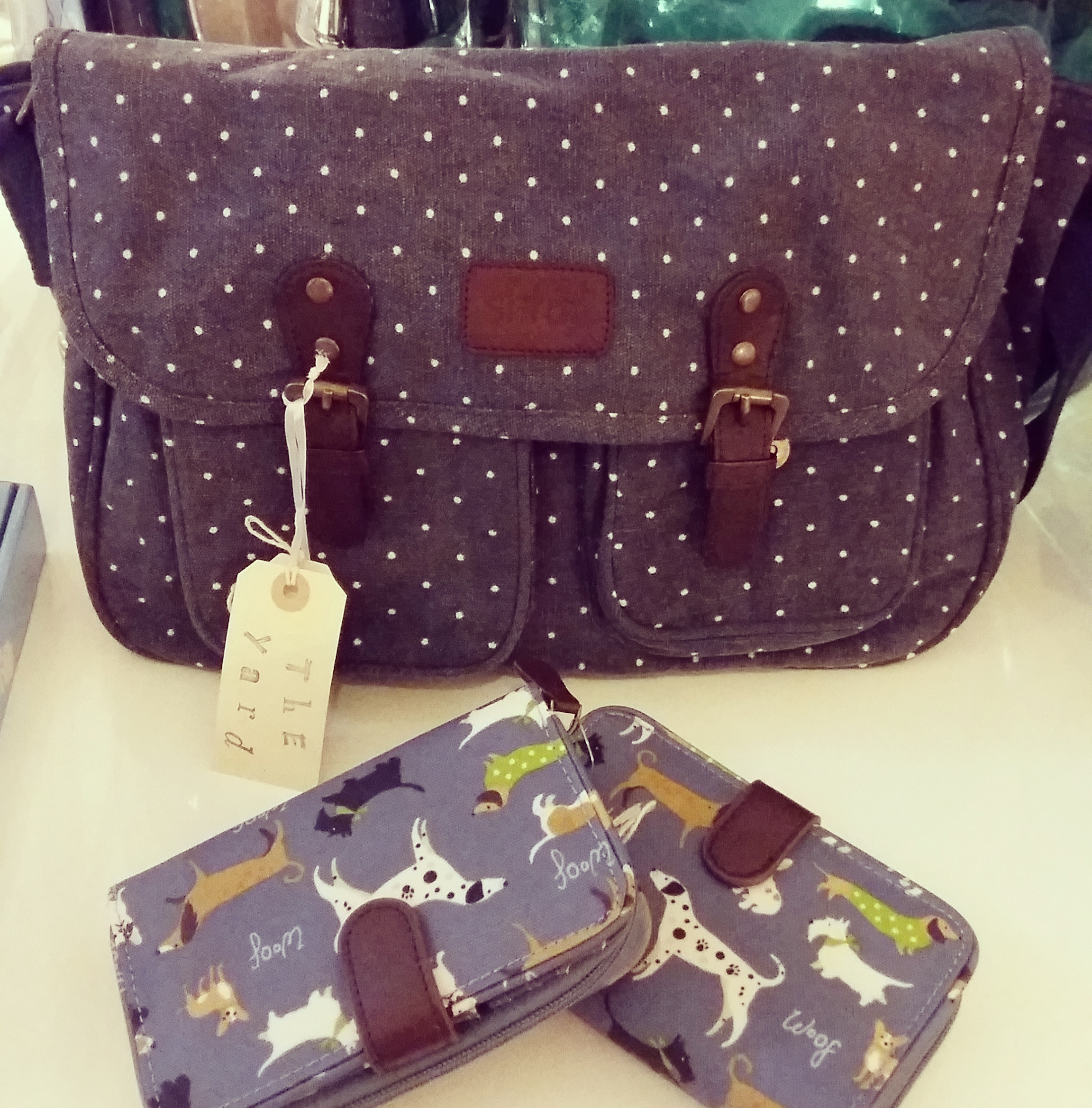 Navy polka dot satchel and dog print oil cloth purses