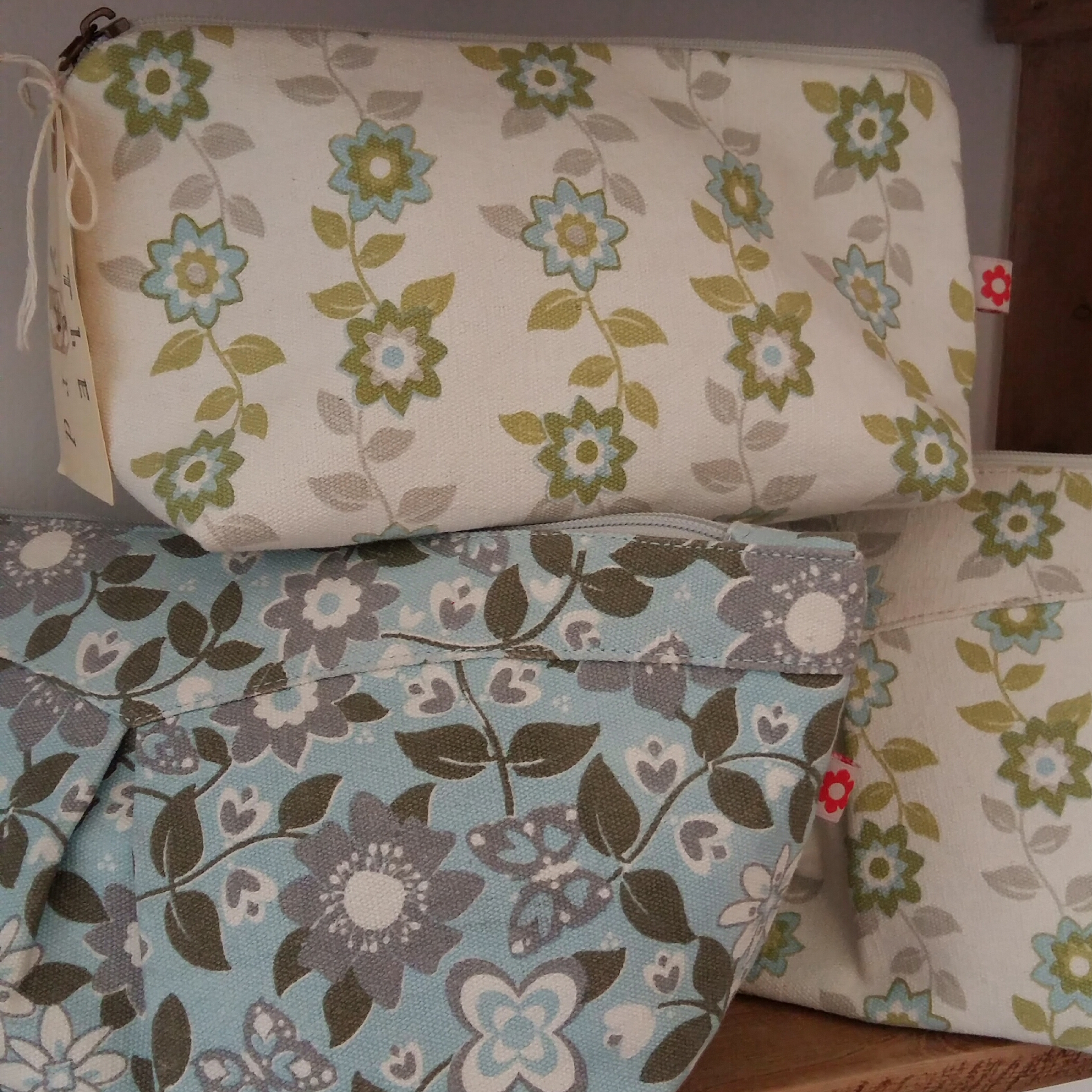 Large and small spring print make up bags