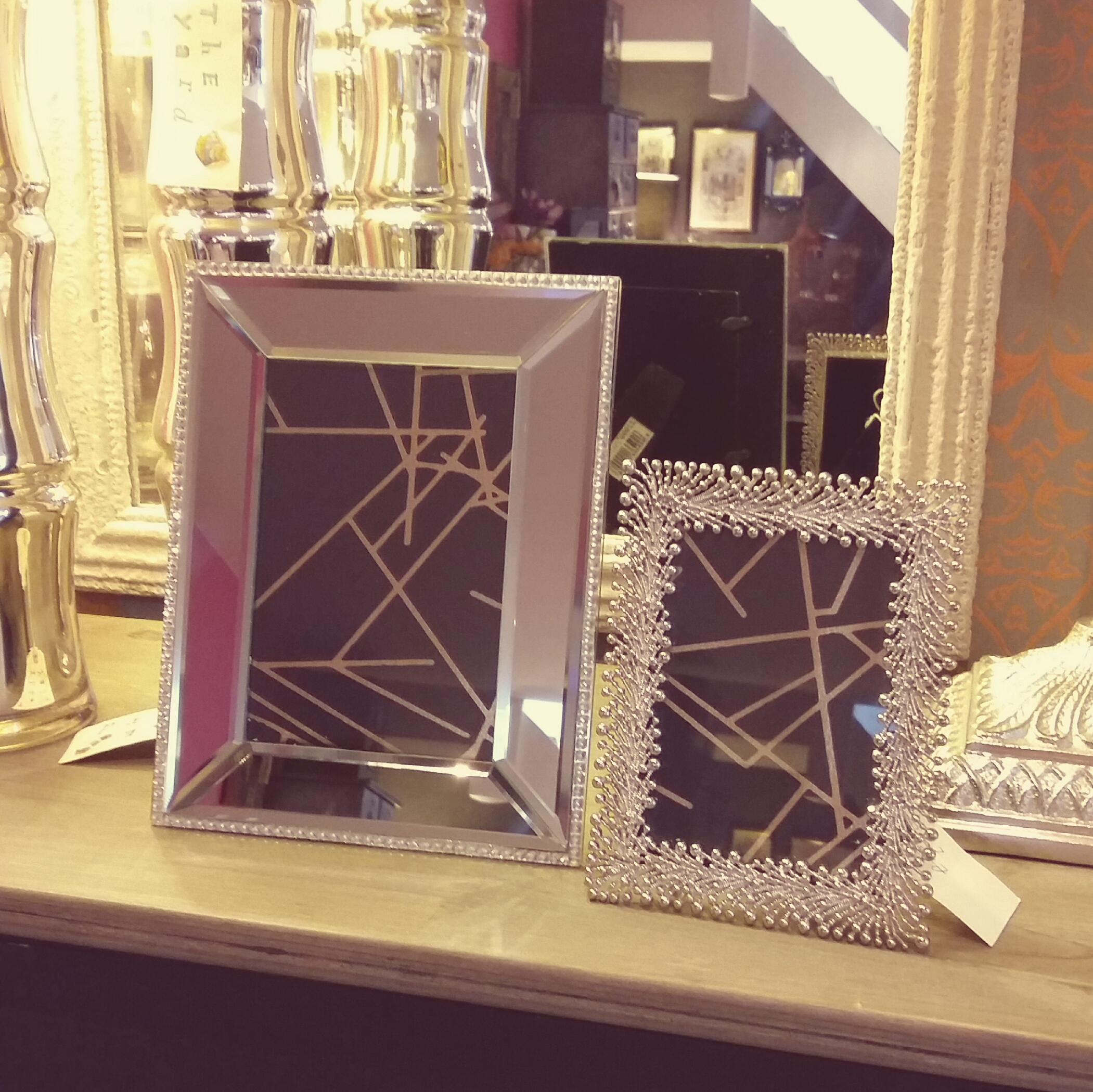 Sliver ornate and mirrored picture frames