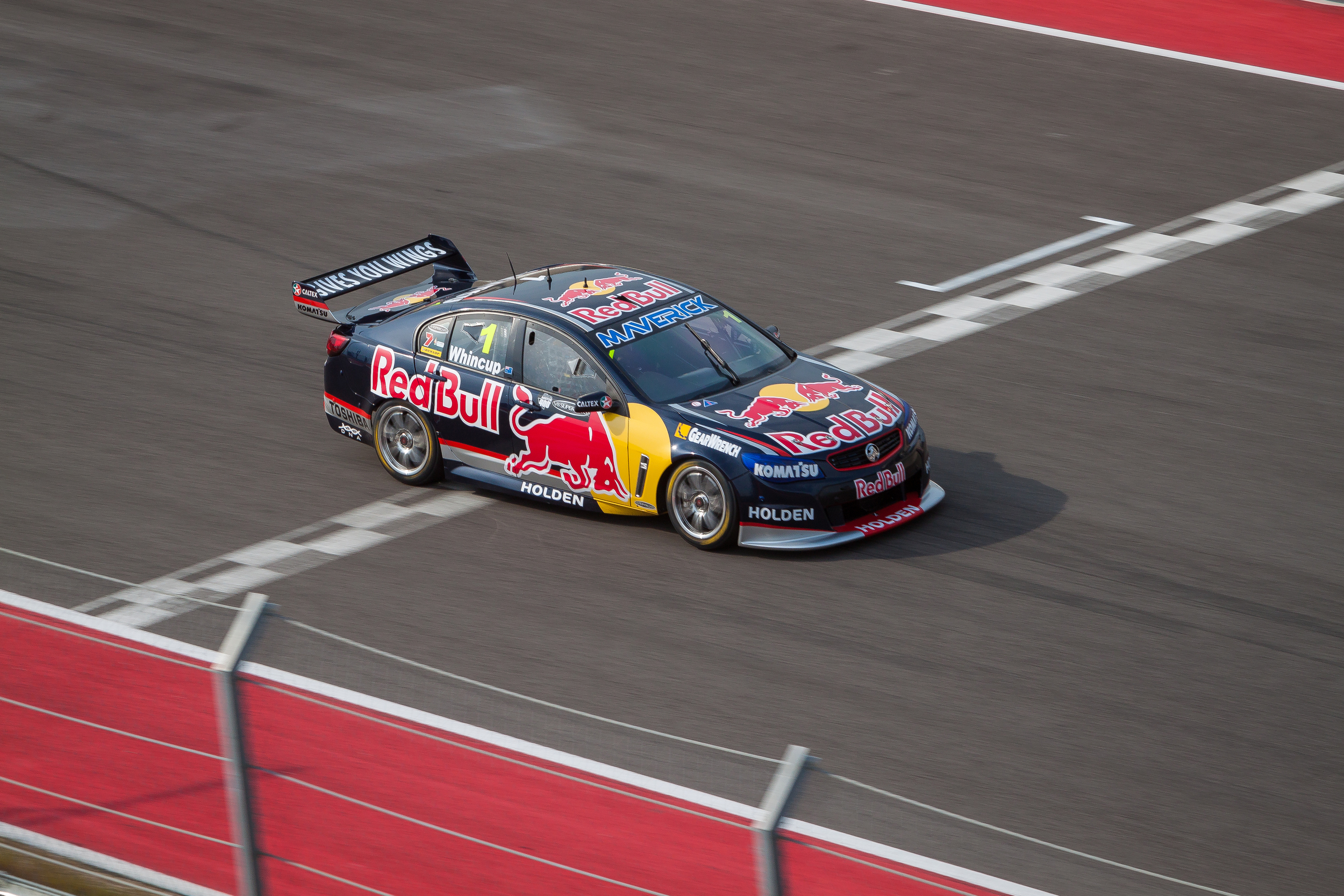 Whincup taking the checkered for The Austin 400 at Circuit of the Americas Race Track in Austin, Texas.
