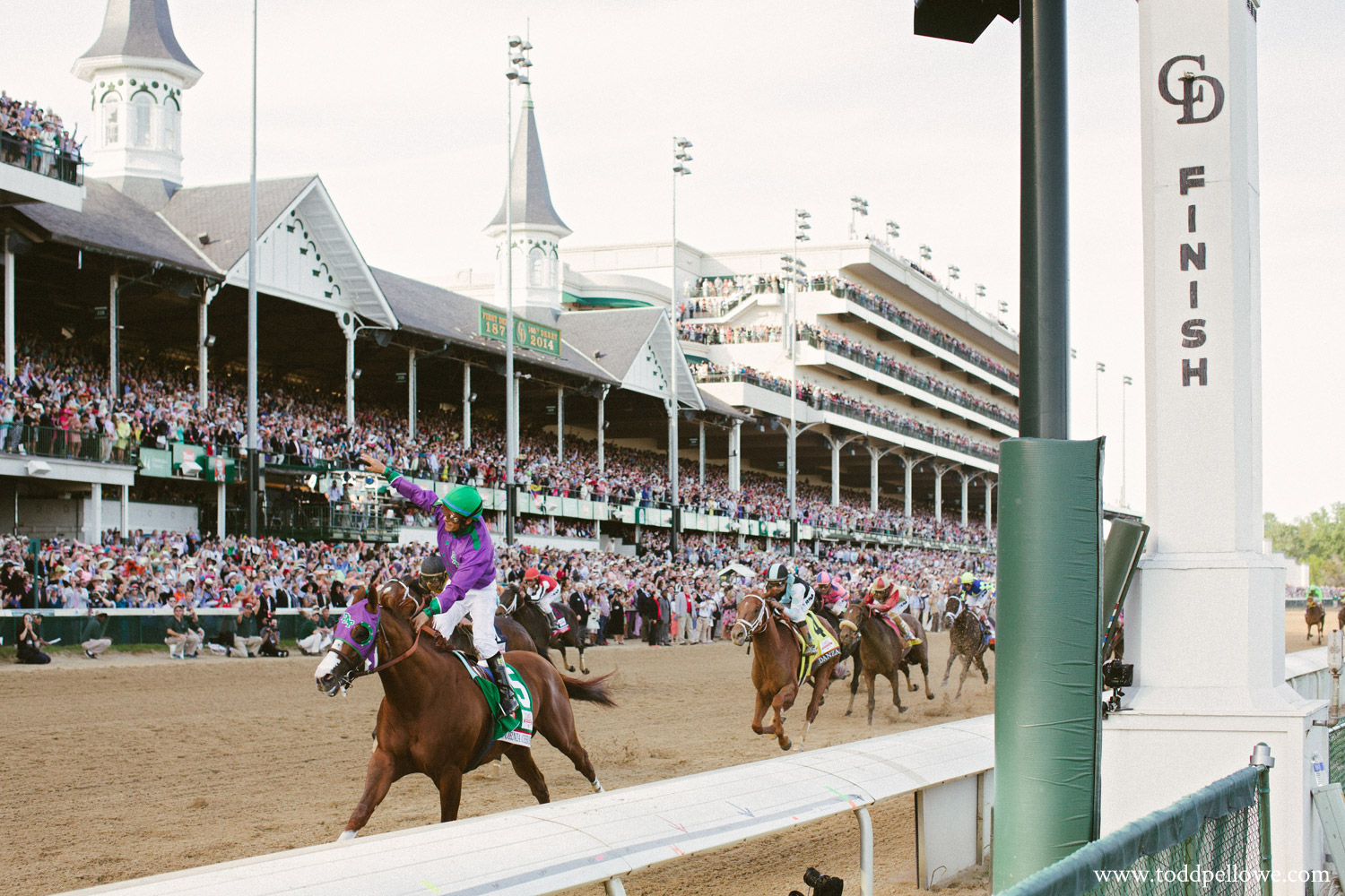 Victor Espinoza crosses finish line aboard California Chrome