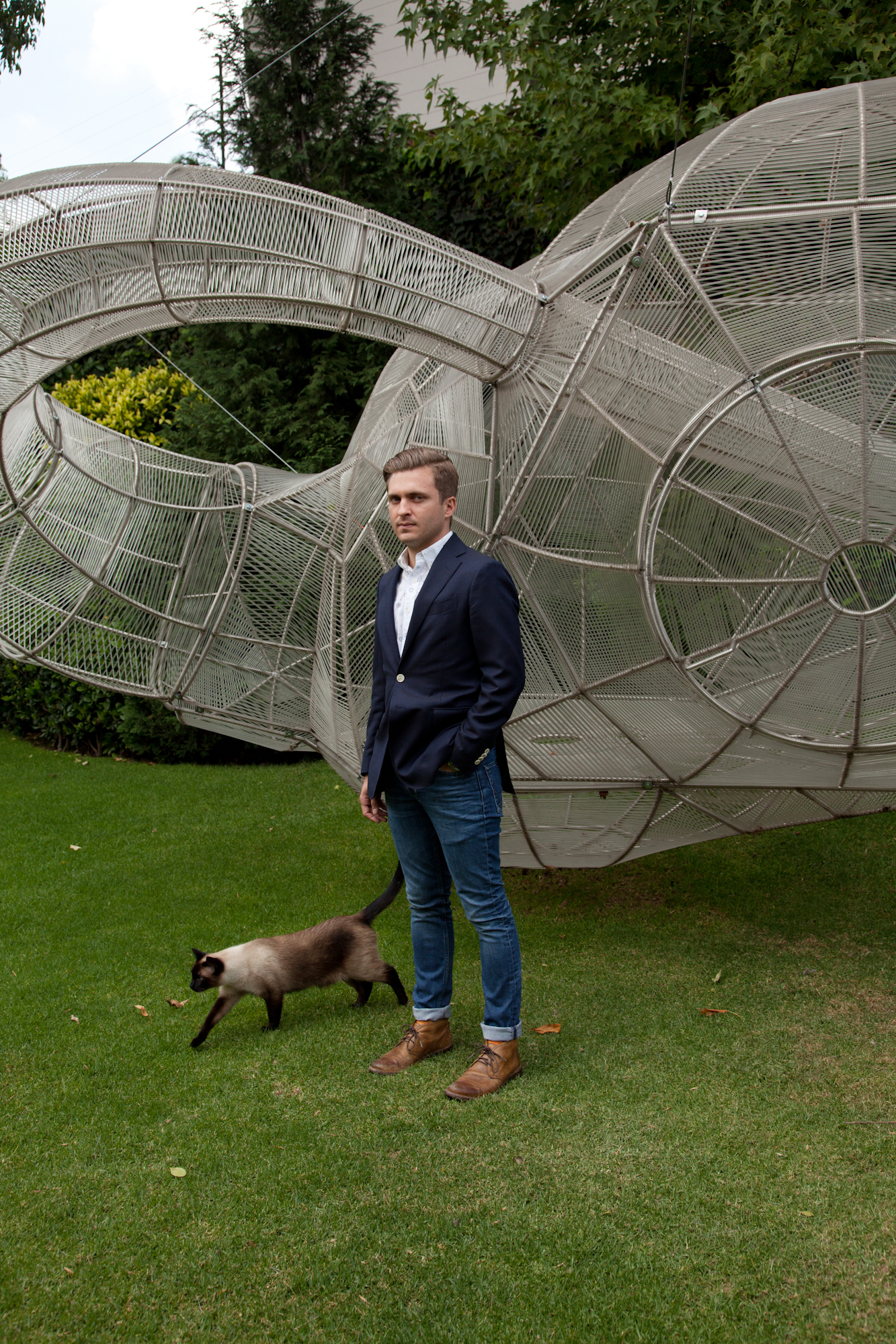 "Moises Cosio Espinosa with Pedro Reyes's ""Capula Klein's Bottle"" (2007) in Mexico City."