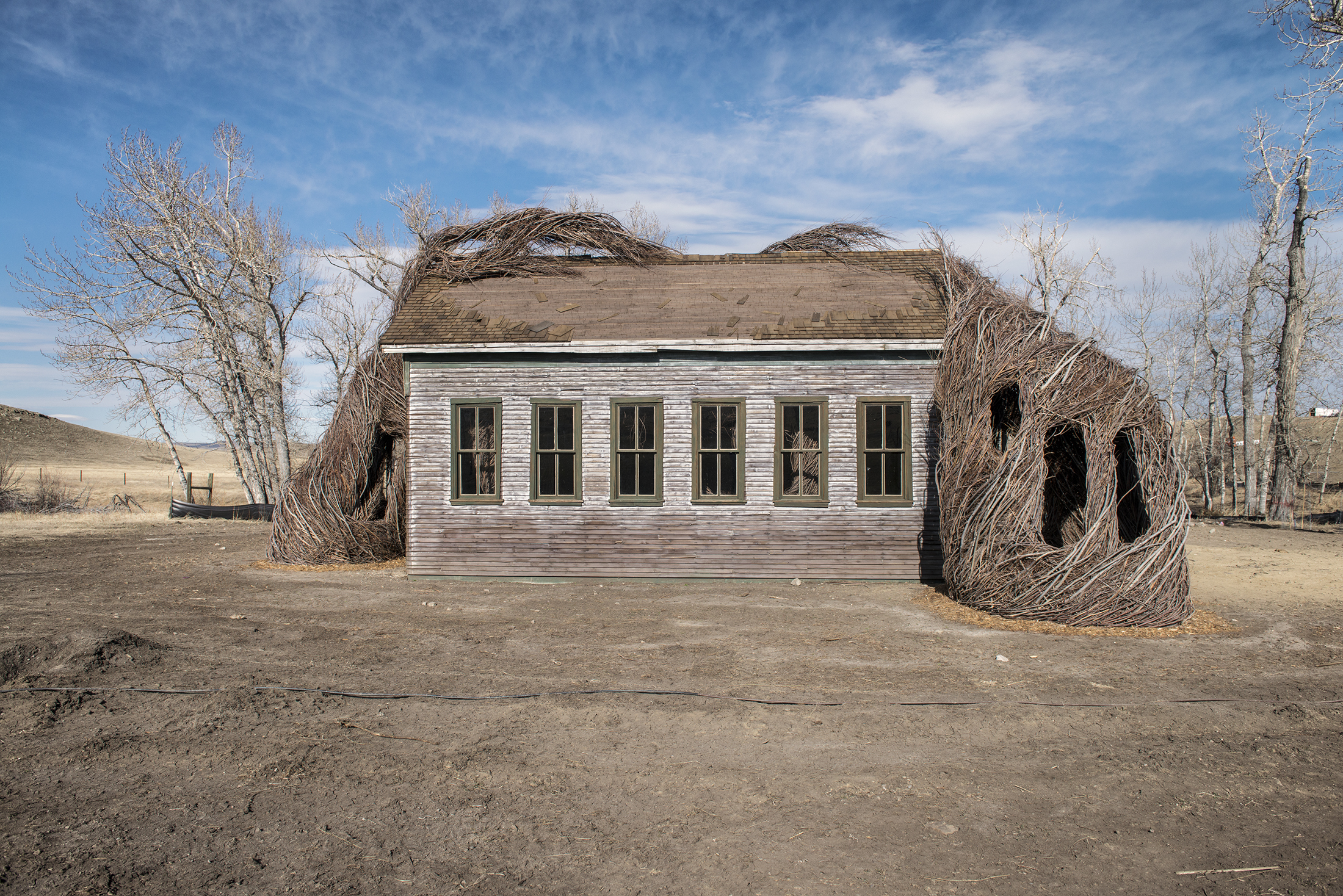 """Patrick Dougherty's """"Daydreams"""" is a model of a nineteenth-century schoolhouse engulfed by a mass of twigs. (Photo: Alexis Pike/Surface)"""