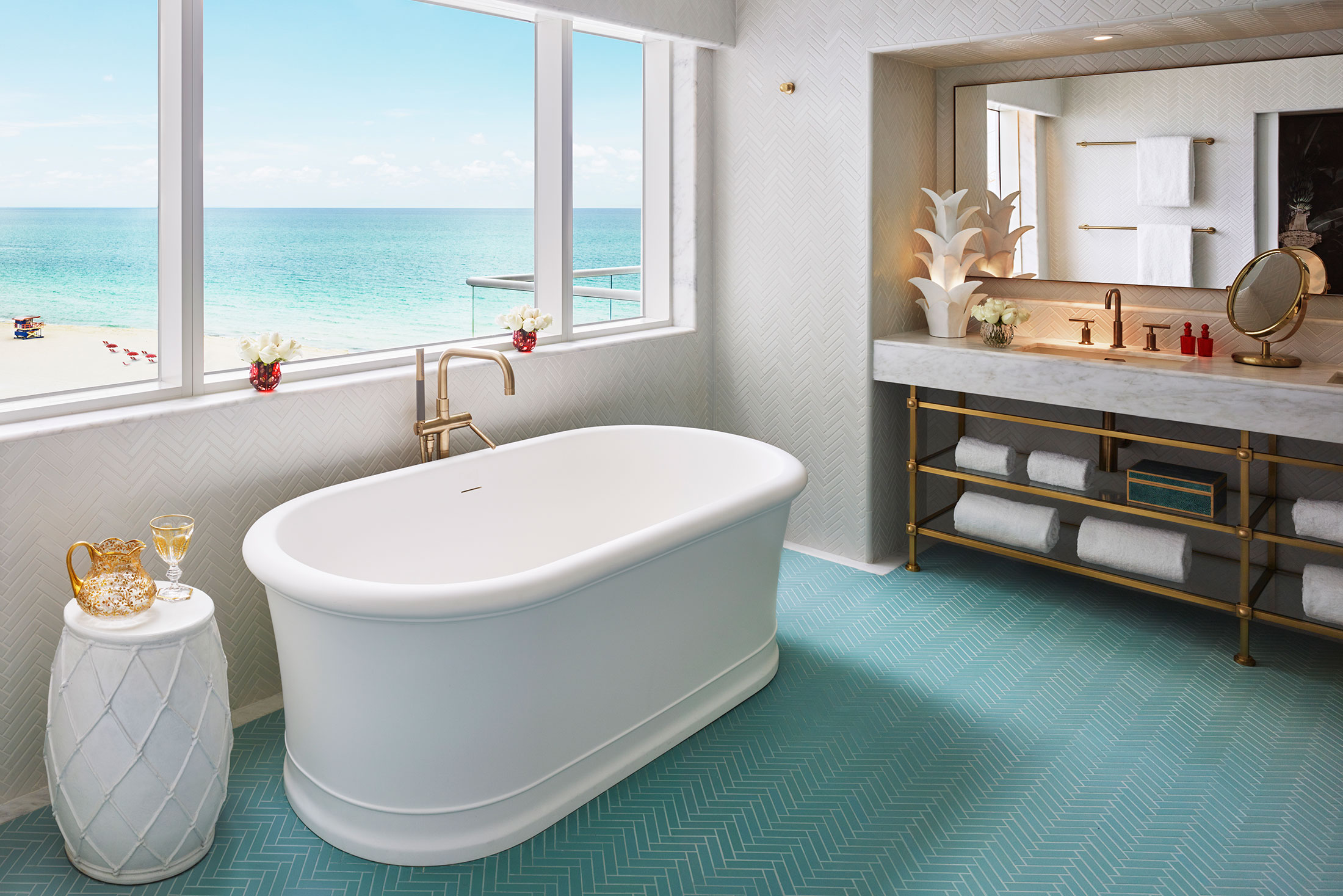 A turquoise-tiled bathroom with a view. (Photo: Courtesy Faena Hotel Miami Beach)