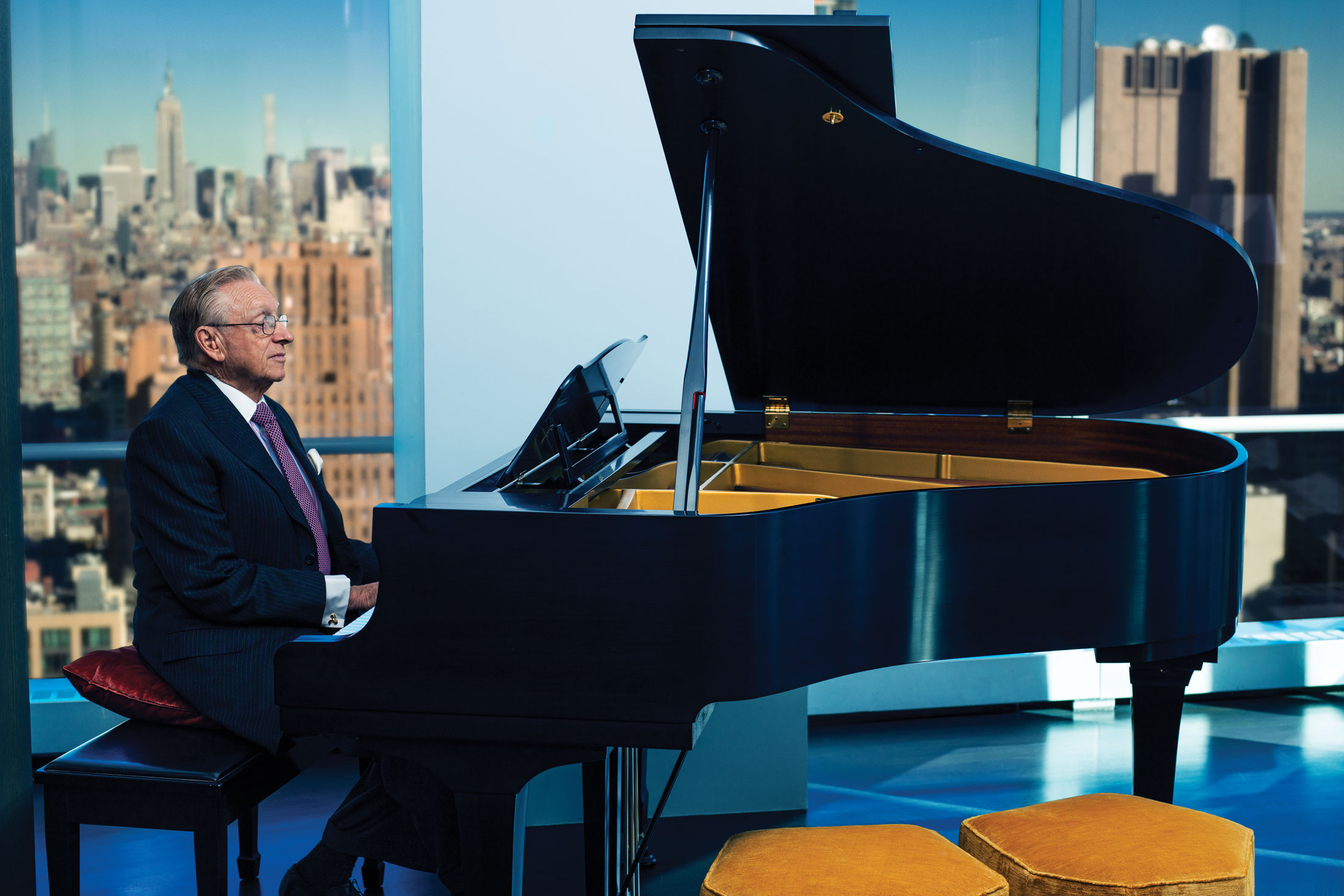Silverstein playing the piano in his 7 World Trade Center office. (Photo: Ogata/Surface)