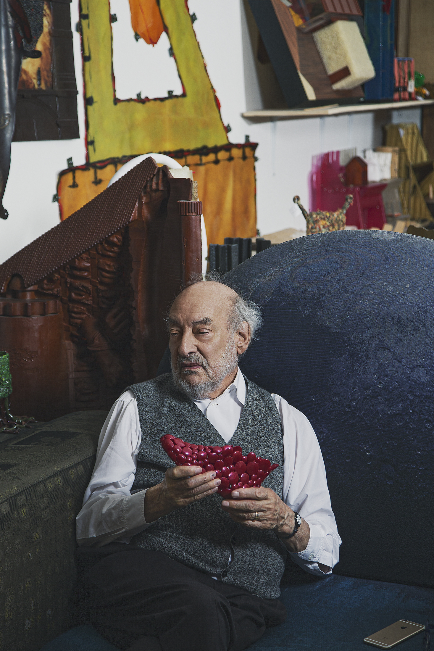 Gaetano Pesce holding a shoe he designed for the brand Melissa. (Photo: Ogata/Surface)