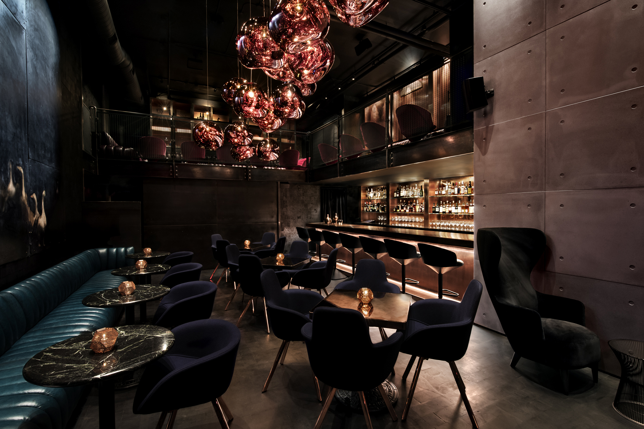 Inside Himitsu, Melt lamps designed by Tom Dixon hang near the bar. (Photo: Emily Andrews)