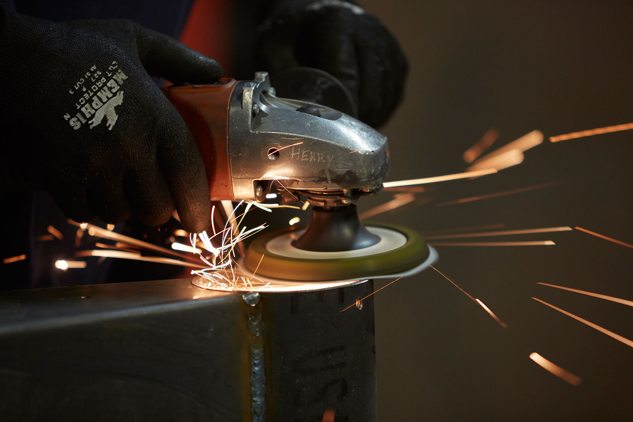 Sparks fly as pieces are shaped in the factory.
