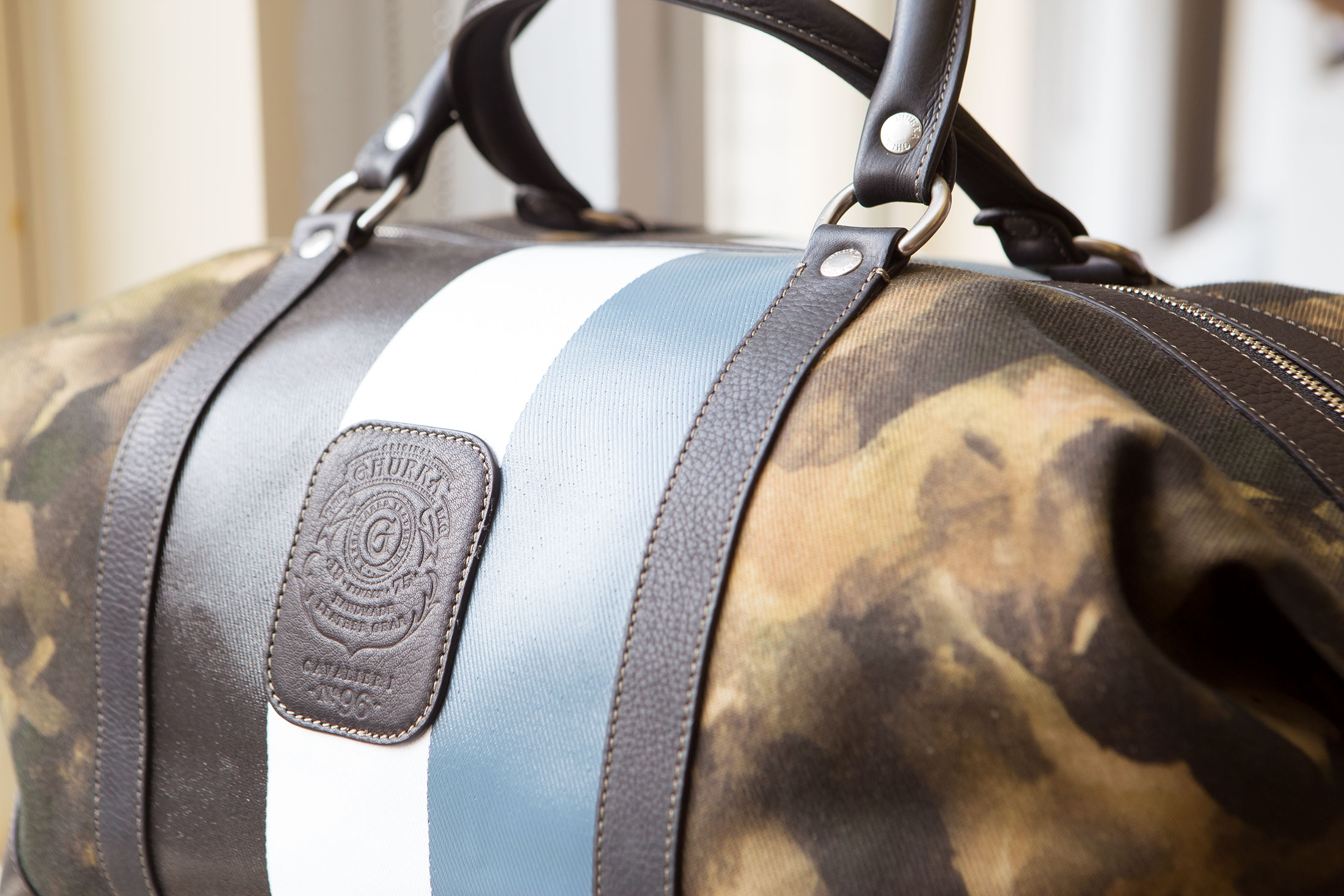A bag from Ghurka's fall collection that features Formby's camouflage-inspired print.