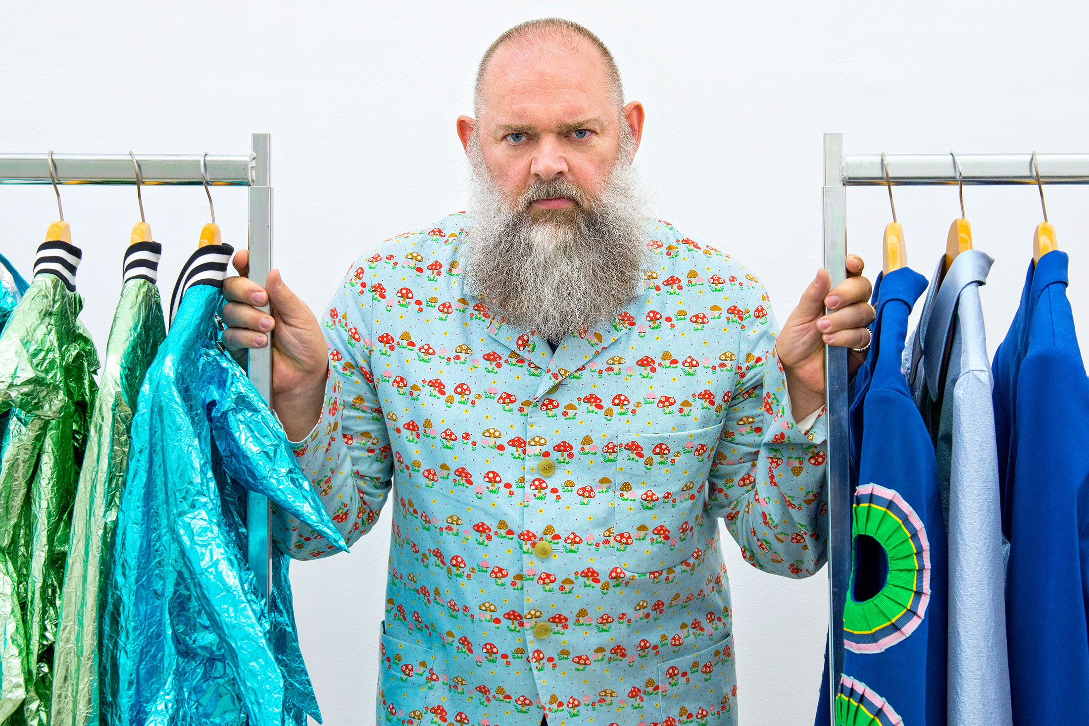 Van Beirendonck among the clothing racks in his showroom. (Photo: Celine Clanet/Surface)