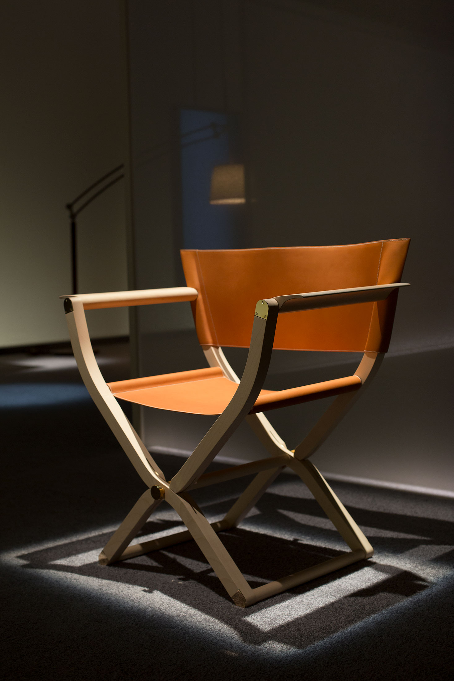 The Pippa folding armchair in natural maple and cowhide, designed by Rena Dumas and Peter Coles.