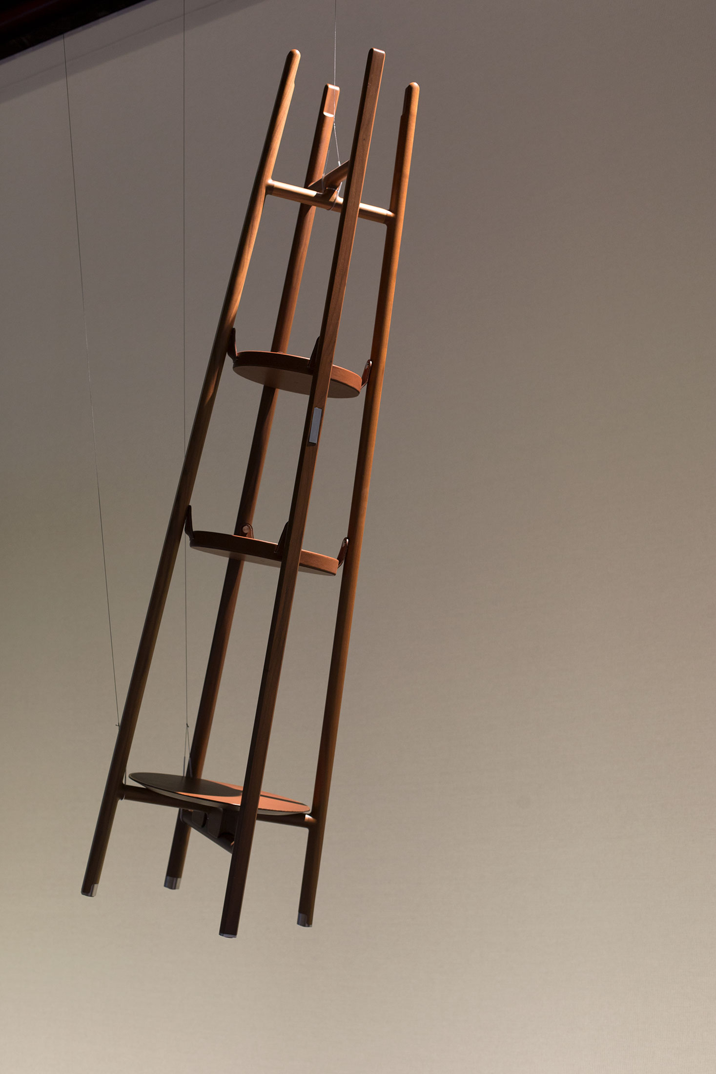 The Vestiare coat rack in Canaletto walnut from Les Nécessaires d'Hermès collection.