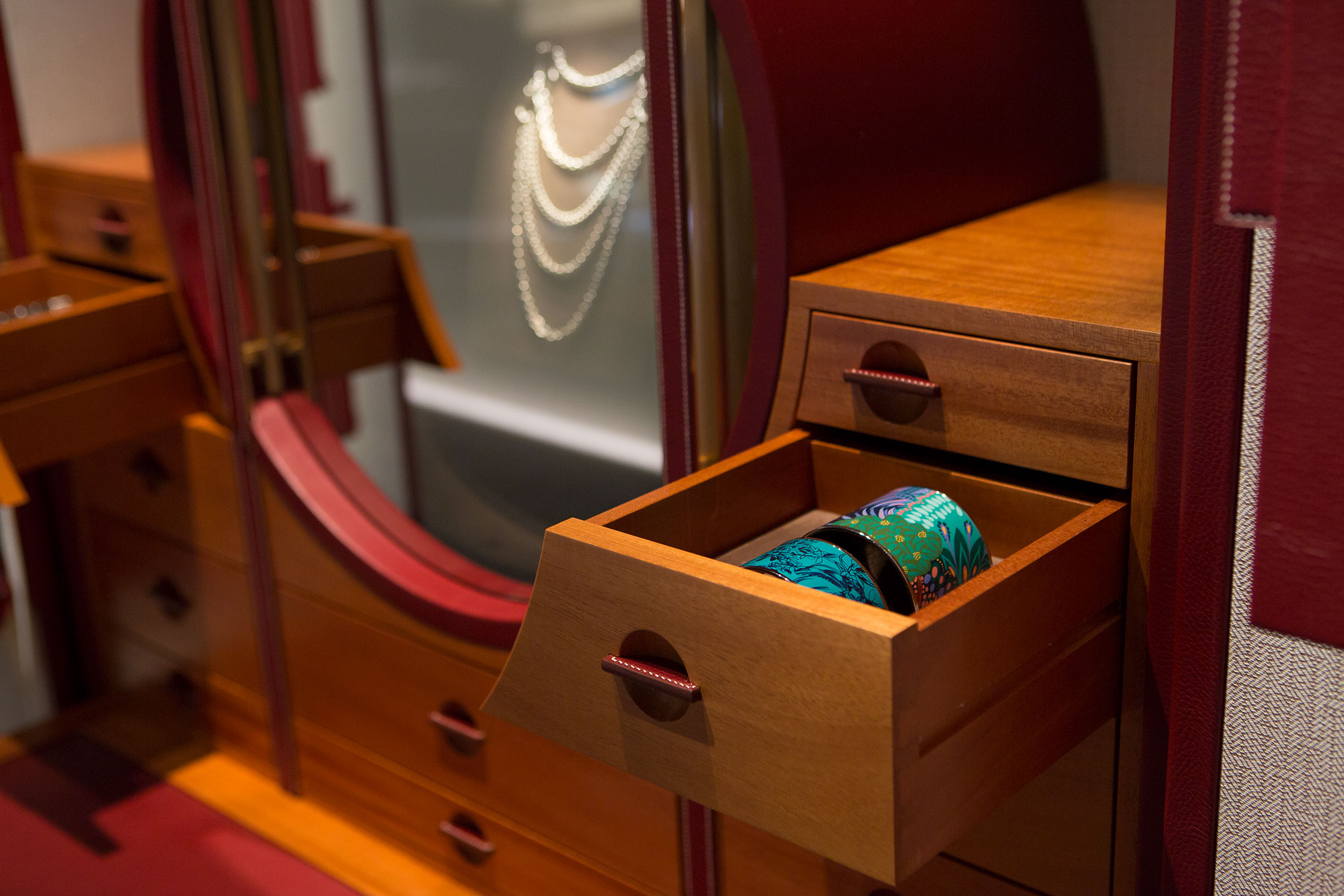The wood, veneer, and leather interior of Les Curiosités d'Hermès jewelry cabinet.