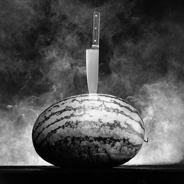 """I relate to the stripped-down essence of Mapplethorpe's photos, and strive for that in my work."" #PeterMarino. - The architect curated an exhibition of #RobertMapplethorpe's work in ""Memento Mori."" Visit surfacemag.com to find out why it makes perfect sense. 📷: Robert Mapplethorpe ""Watermelon with Knife"" (1986). (Courtesy: Robert Mapplethorpe Foundation)"