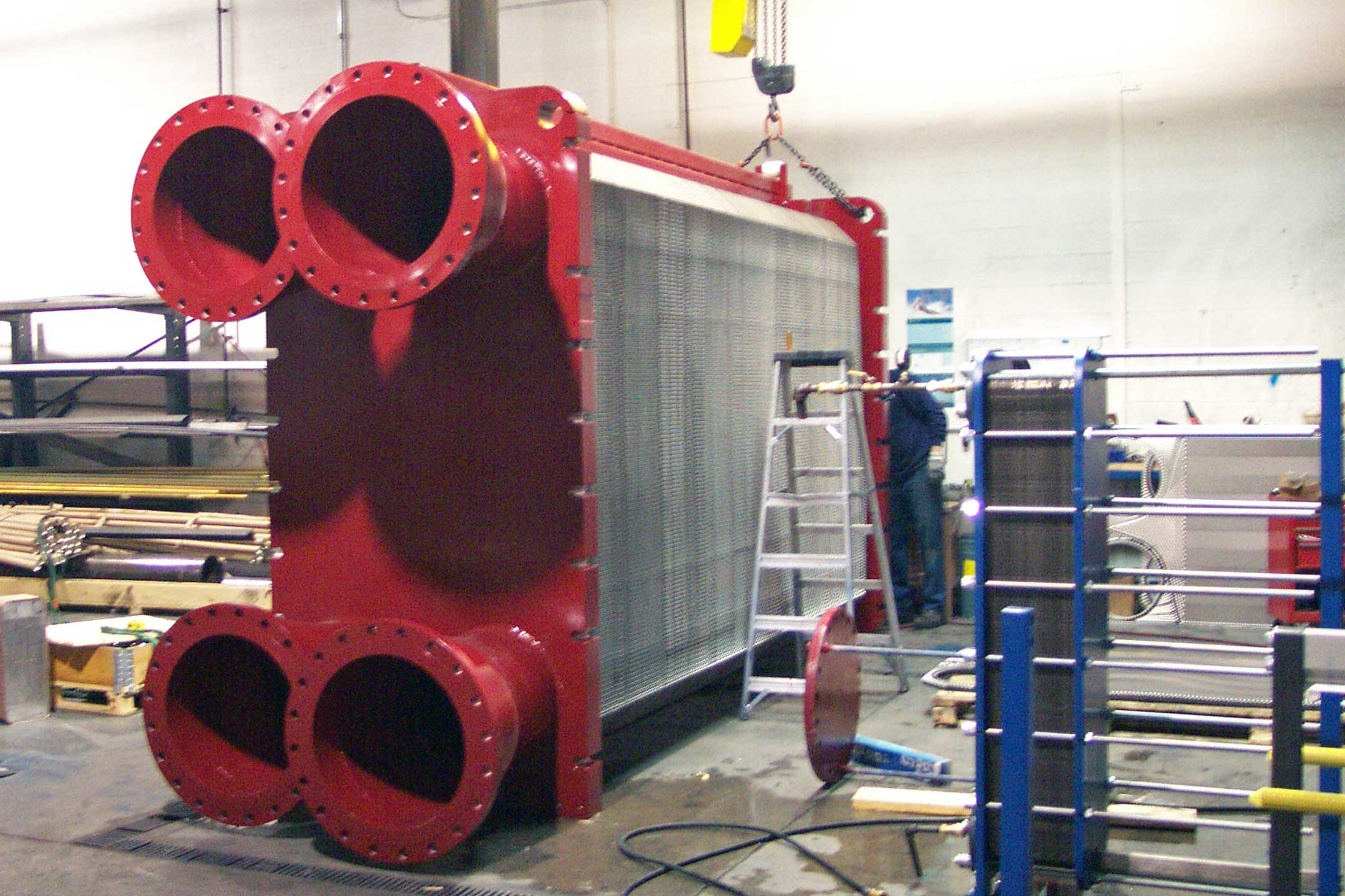 "Closed Water Exchanger  Port Size:  20"" Heat Capacity:  57 MMBtu/hr Heat Transfer Area:  12,000  sq ft"
