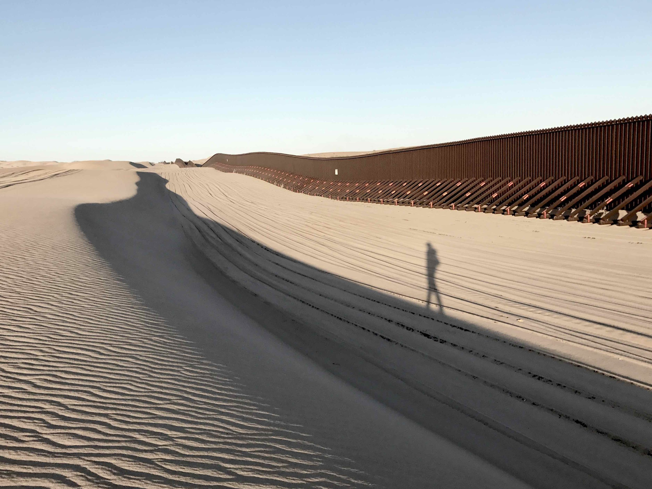 Photographing the US/Mexico border wall at the Algadones Sand Dunes, California