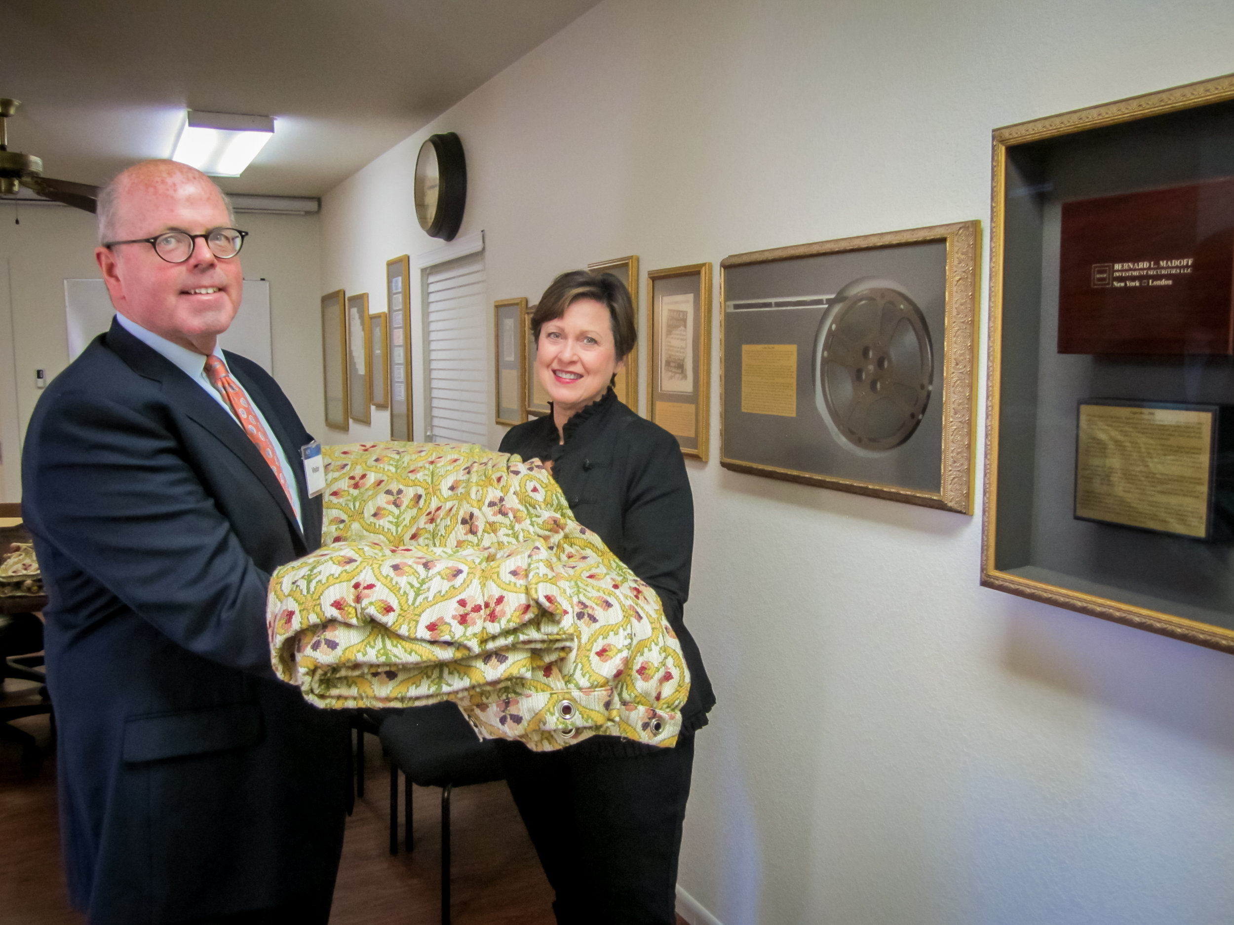 Dennis Lynch, former Tyco VP and Chief Litigation Counsel, delivers the infamous shower curtain to ACFE Chief Operations Officer Jeanette LeVie.