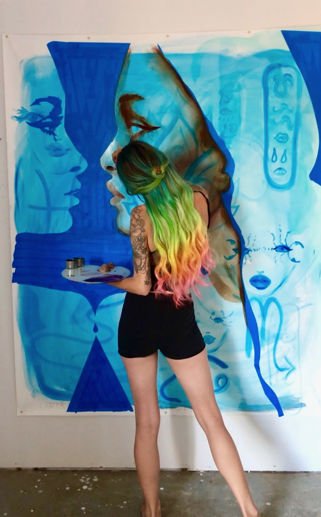 Charmaine Olivia painting for her upcoming show. Photo by Adam Casper
