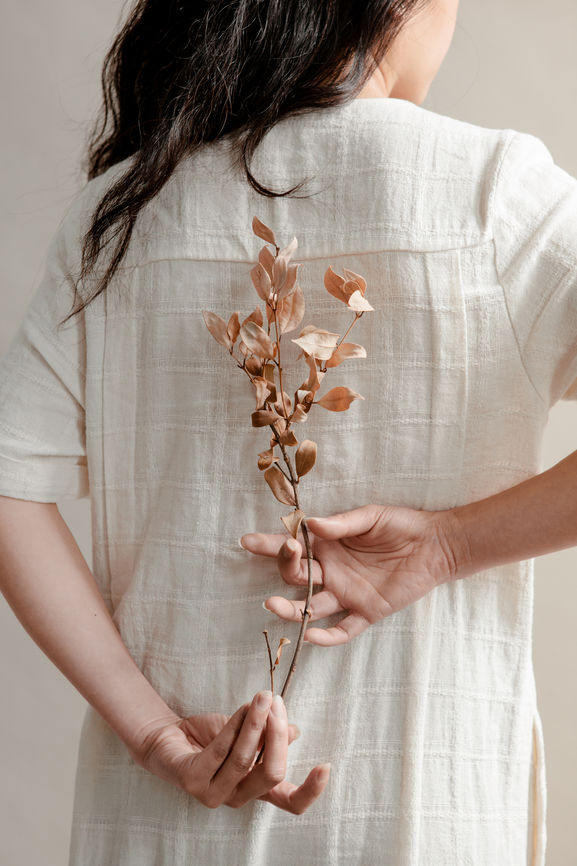 Young Woman Holding Dried Florals