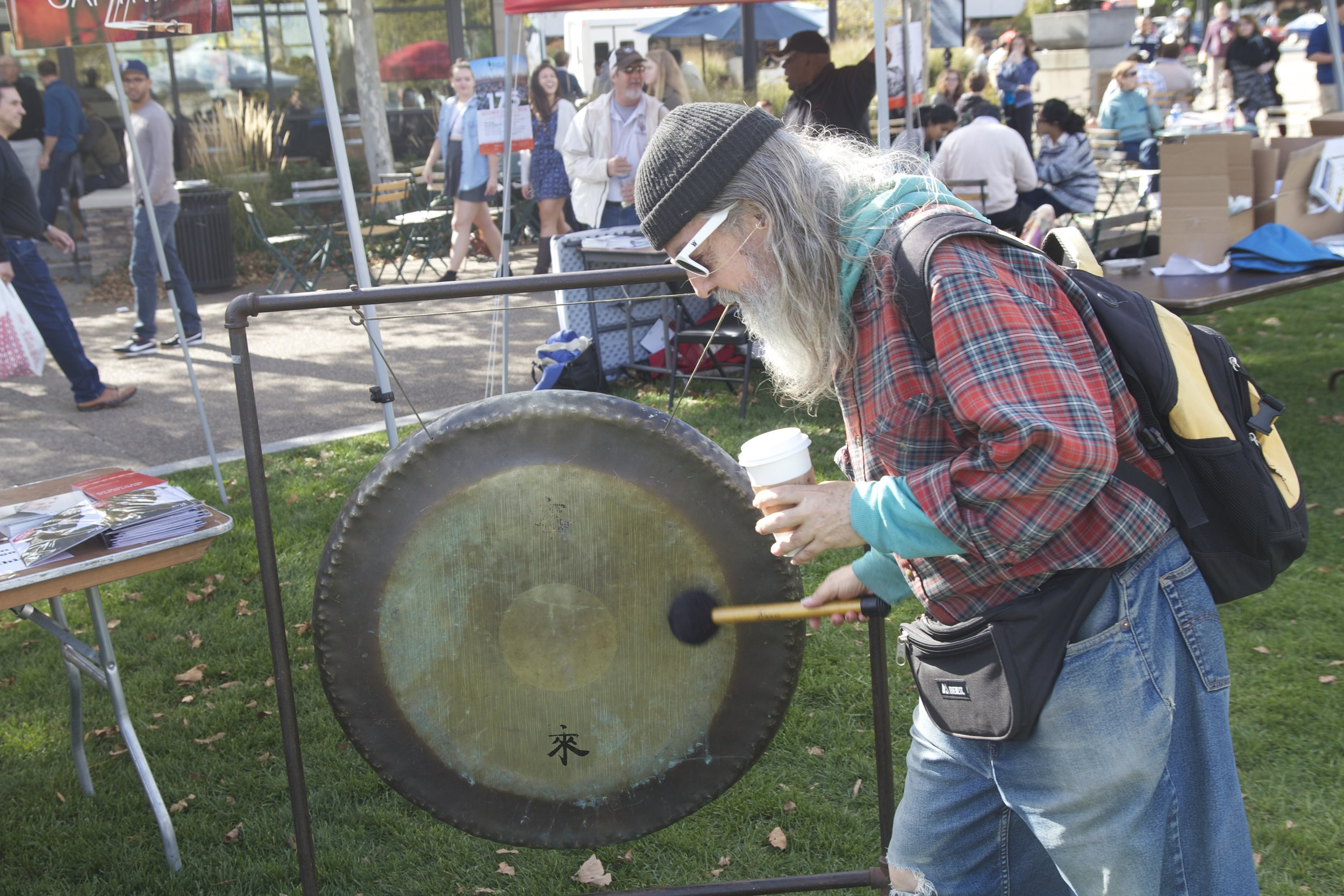 Trying out the gong in Pittsburgh's Schenley Plaza