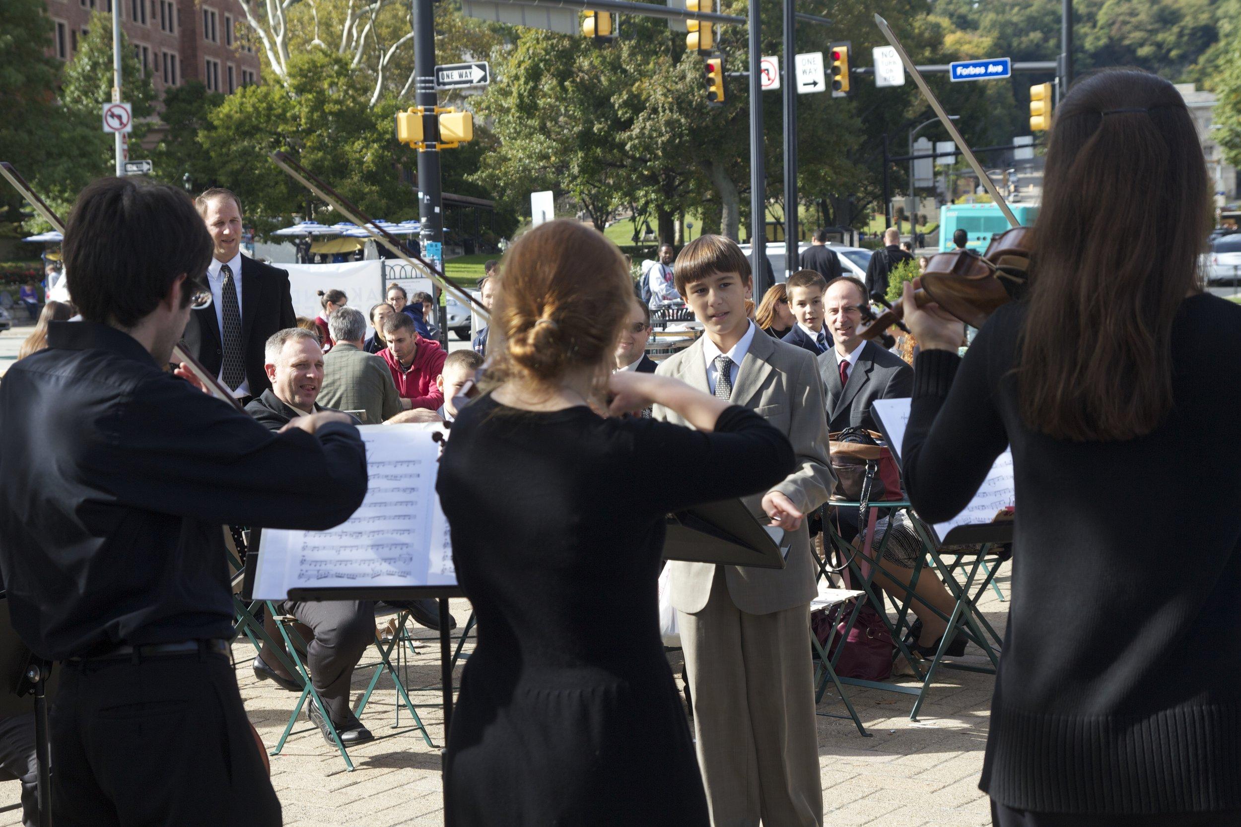 Conduct Us ensemble in Schenley Plaza