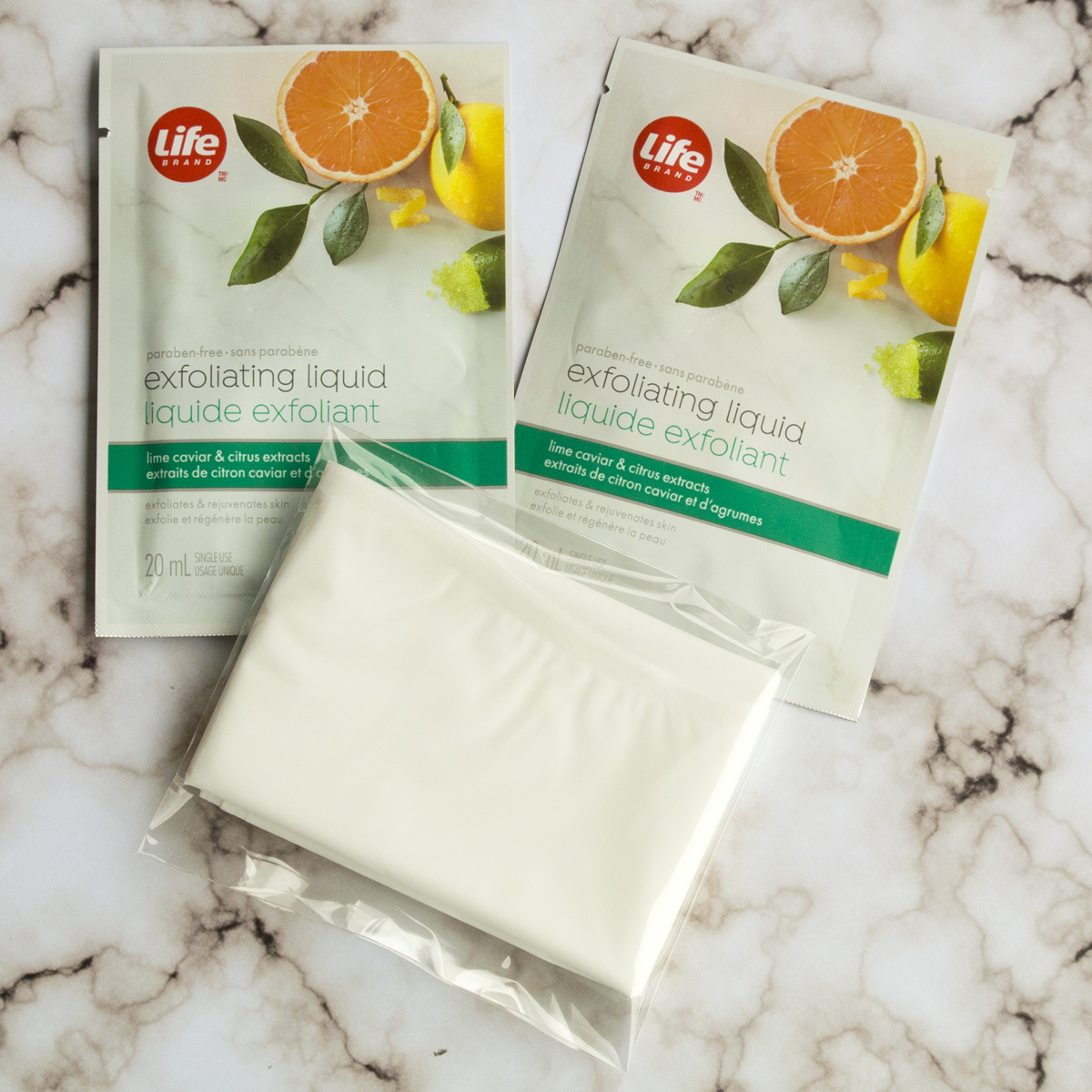 The interior of the Life Brand Exfoliating Foot Mask Package - Two gel packs and one pair of booties.