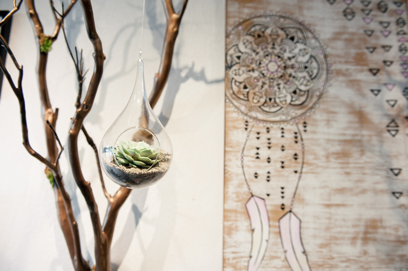 Plants, found items, and artwork all blend seamlessly.