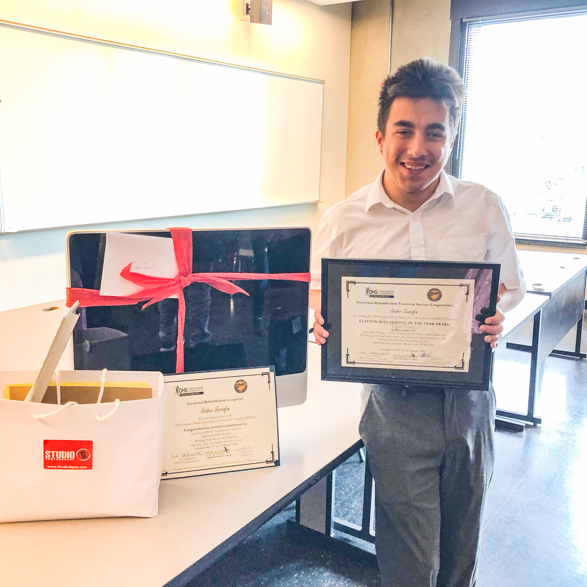 Isidro with his SWIFTY of the Year Award (and some gifts from his mentors - Brian & Sandy.