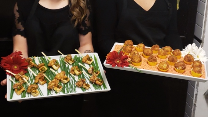 Farmfare servers share appetizers with guests.