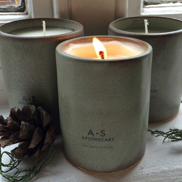 A candle burning to celebrate new beginnings and seasonal endings