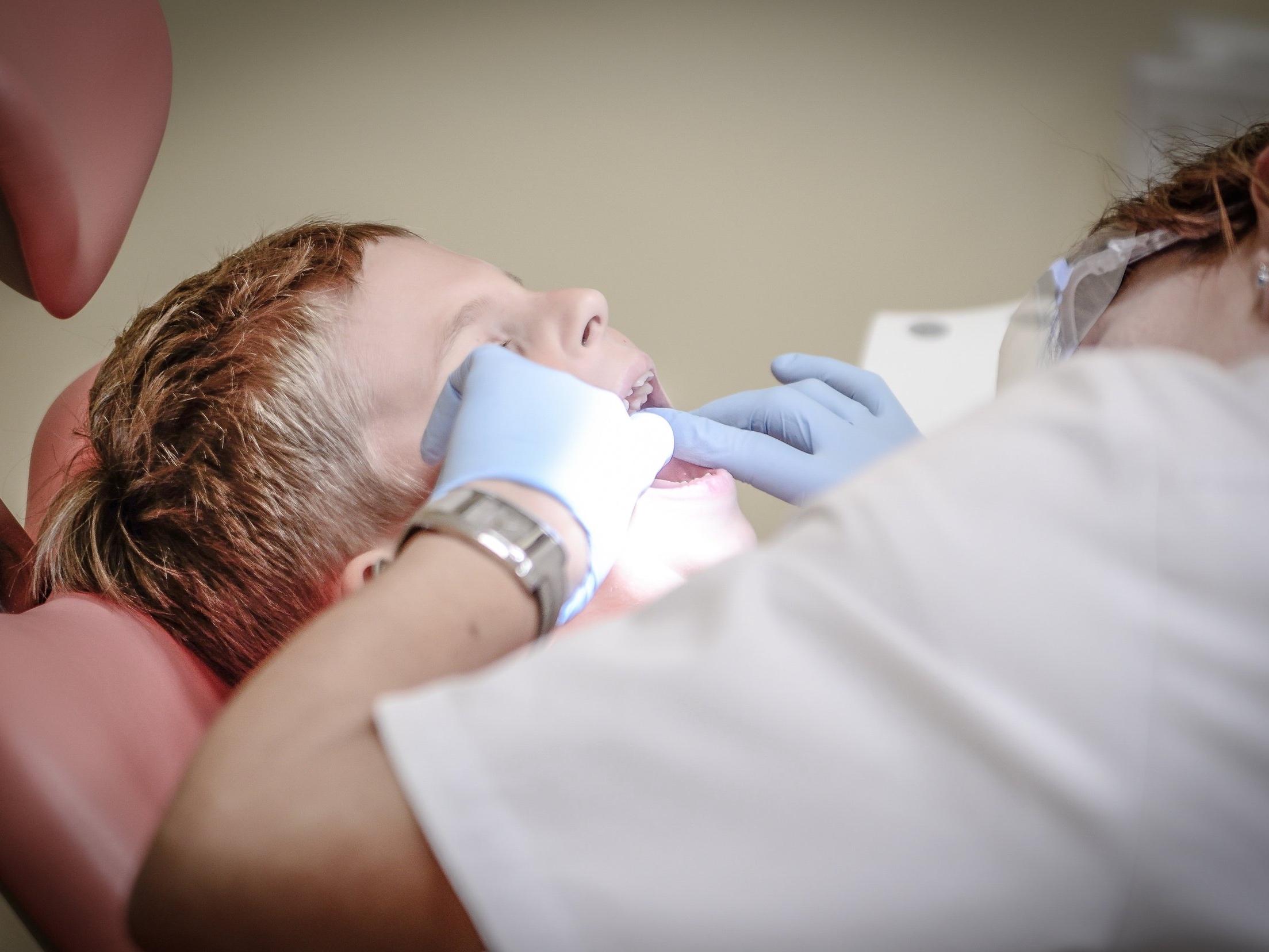 boy-check-up-dental-care-52527.jpg