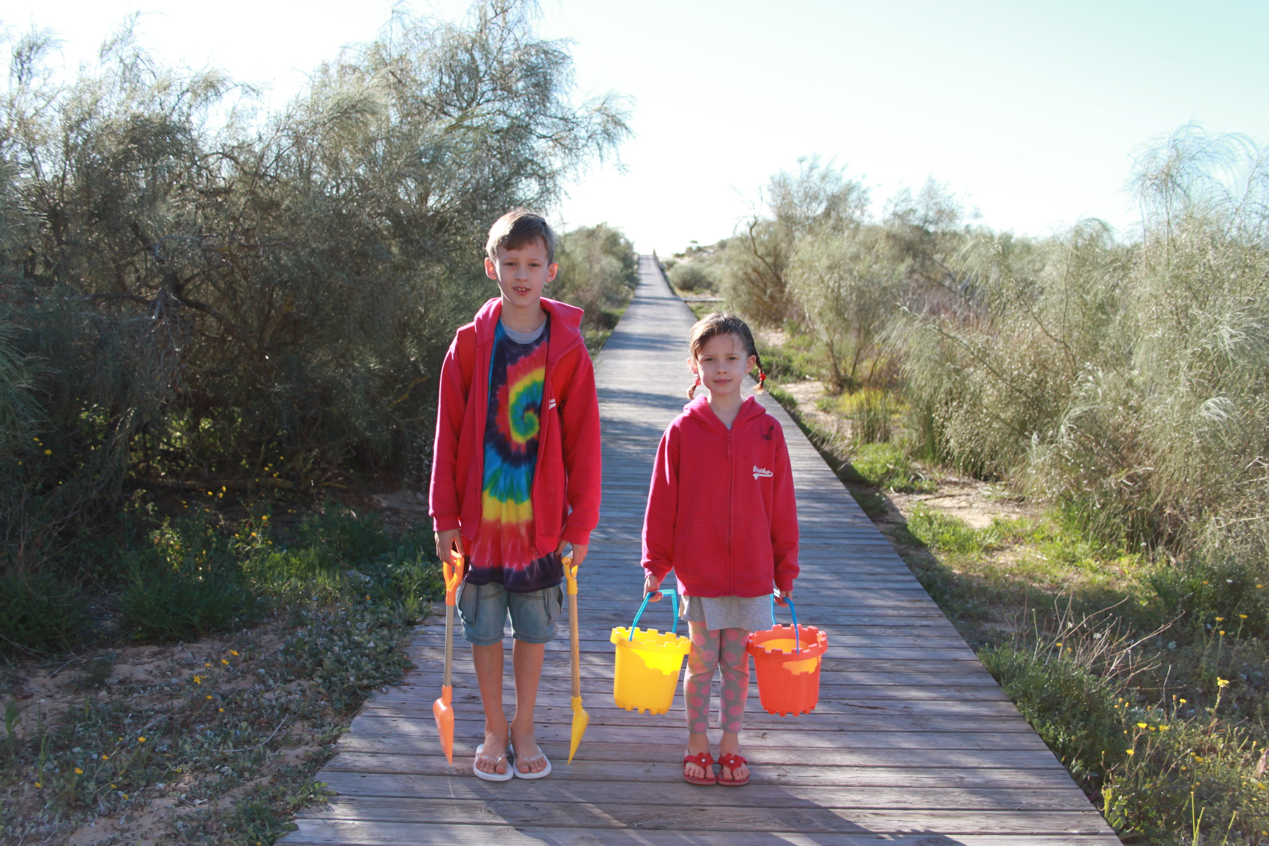 Truman (8) and Martha (6) off to dig holes on the beach in the early morning sunshine...