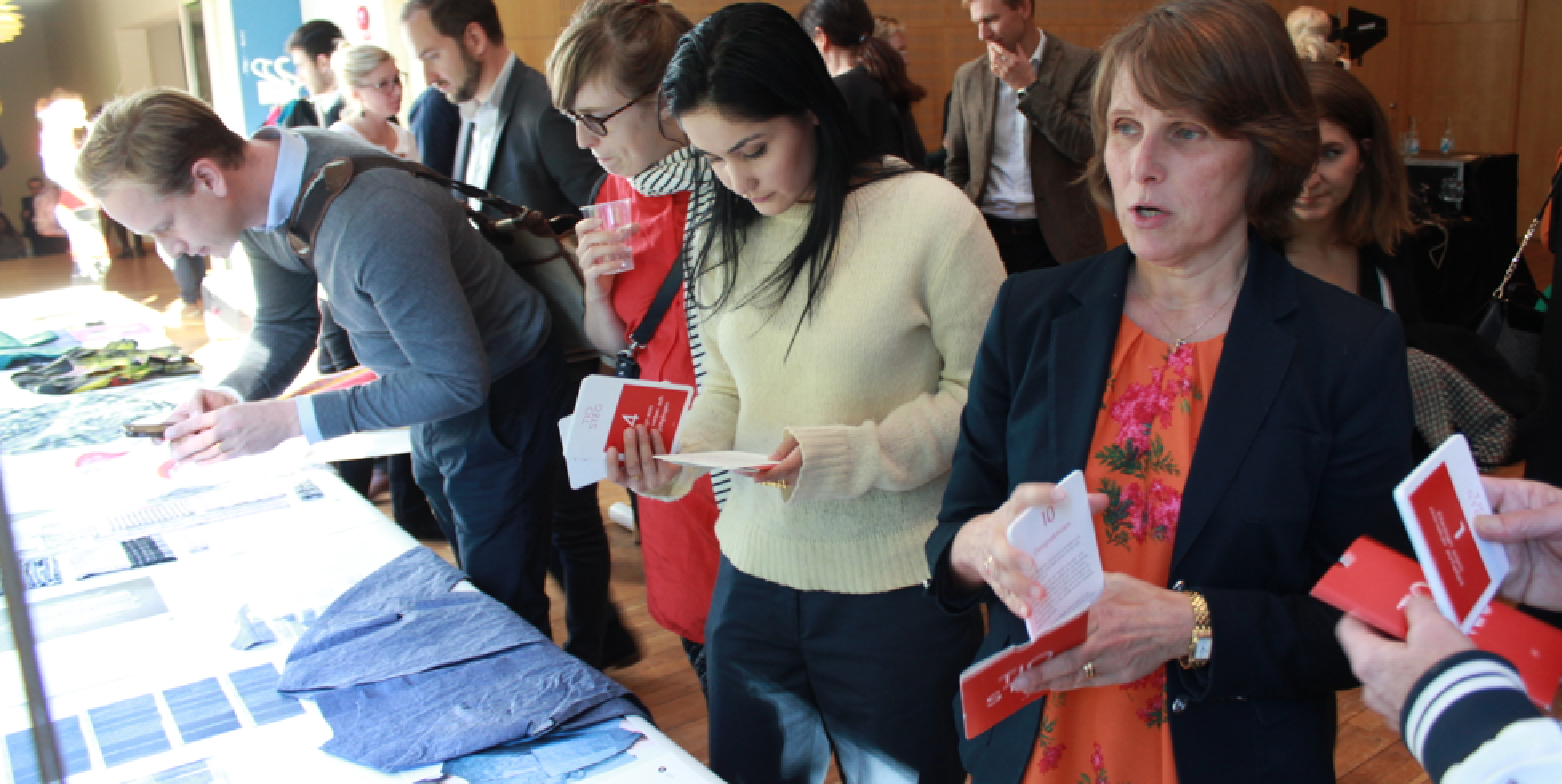 Industry visitors look at the Textile Toolbox work and the Swedish language TED's The TEN cards, at the launch of the Mistra Future Fashion Manifesto, held at Stockholm School of Economics, September 2015.