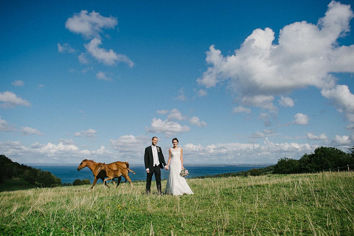 Wedding couple and horses