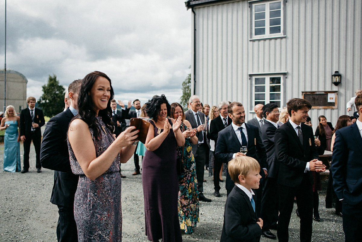 Guests cheering for the wedding couple