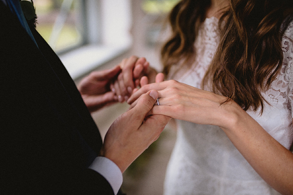 Close up of the wedding couples hands