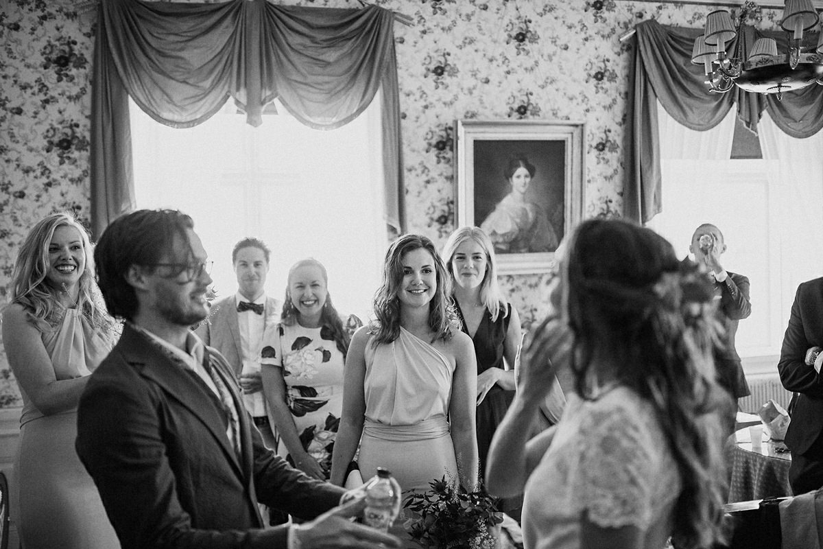 Friends sees the wedding couple